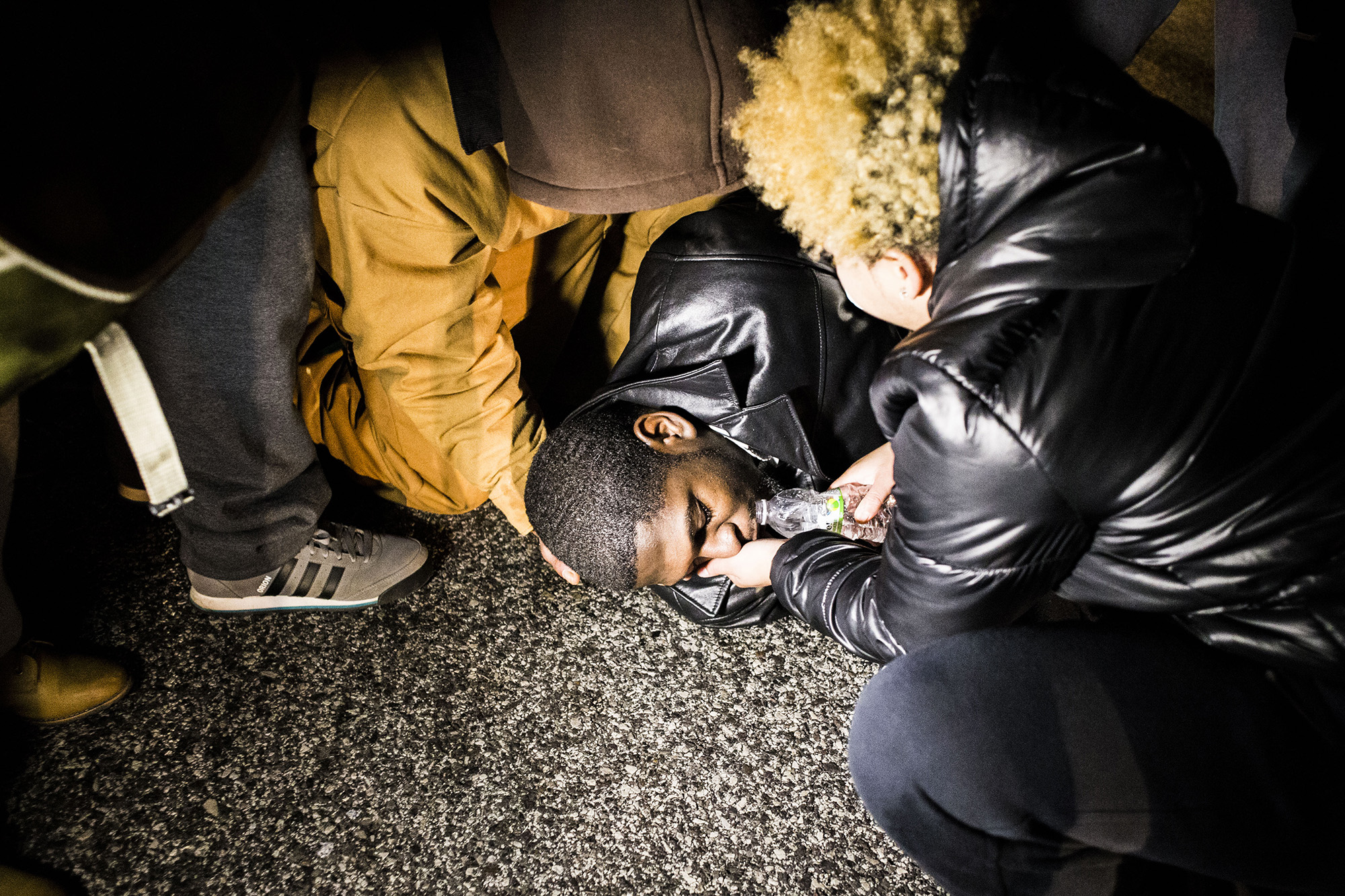A protester lays on the street after police sprayed him with tear gas on Nov. 24, 2014, Ferguson, MO.