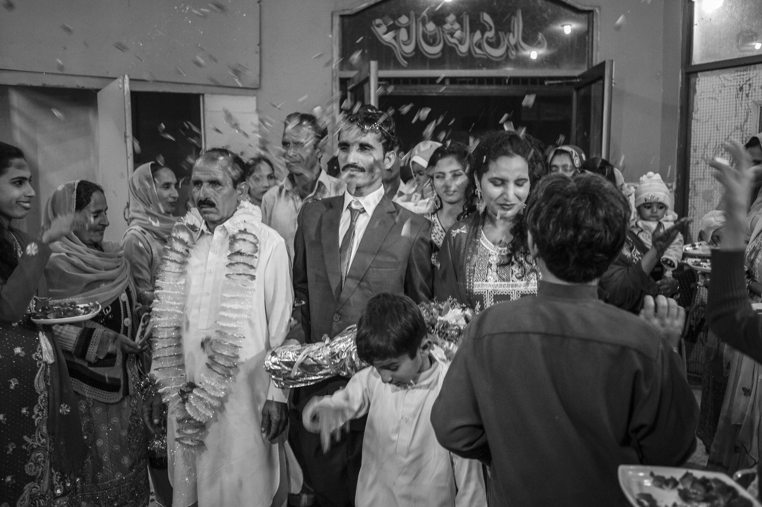 Arshad Ali (Left) arrives at his wedding ceremony along with his family to marry Sarwari Bibi, an acid attack survivor, on Jan. 7, 2016 in Lahore, Pakistan.