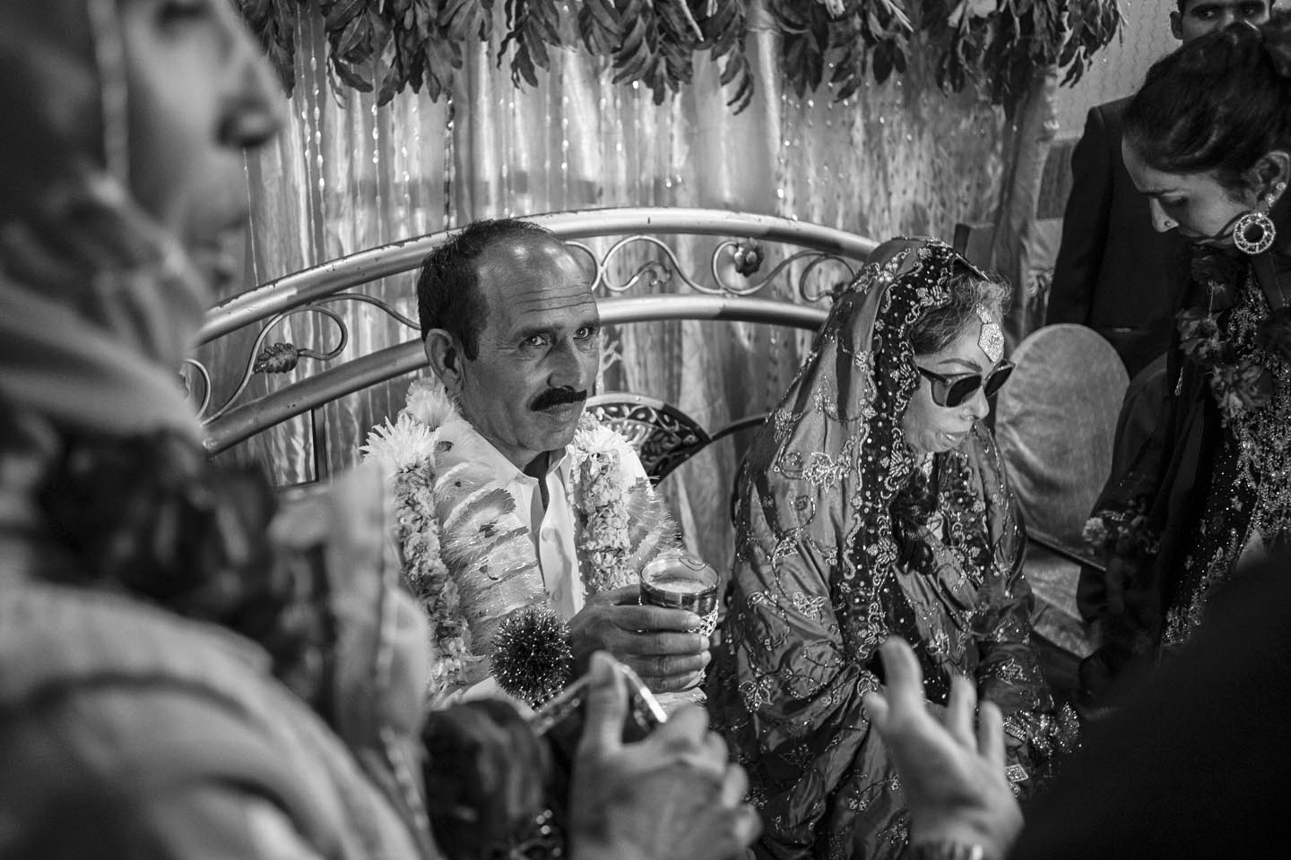 Arshad Ali (Left) sips milk as part of a wedding tradition at the ceremony on Jan. 7, 2016 in Lahore, Pakistan.