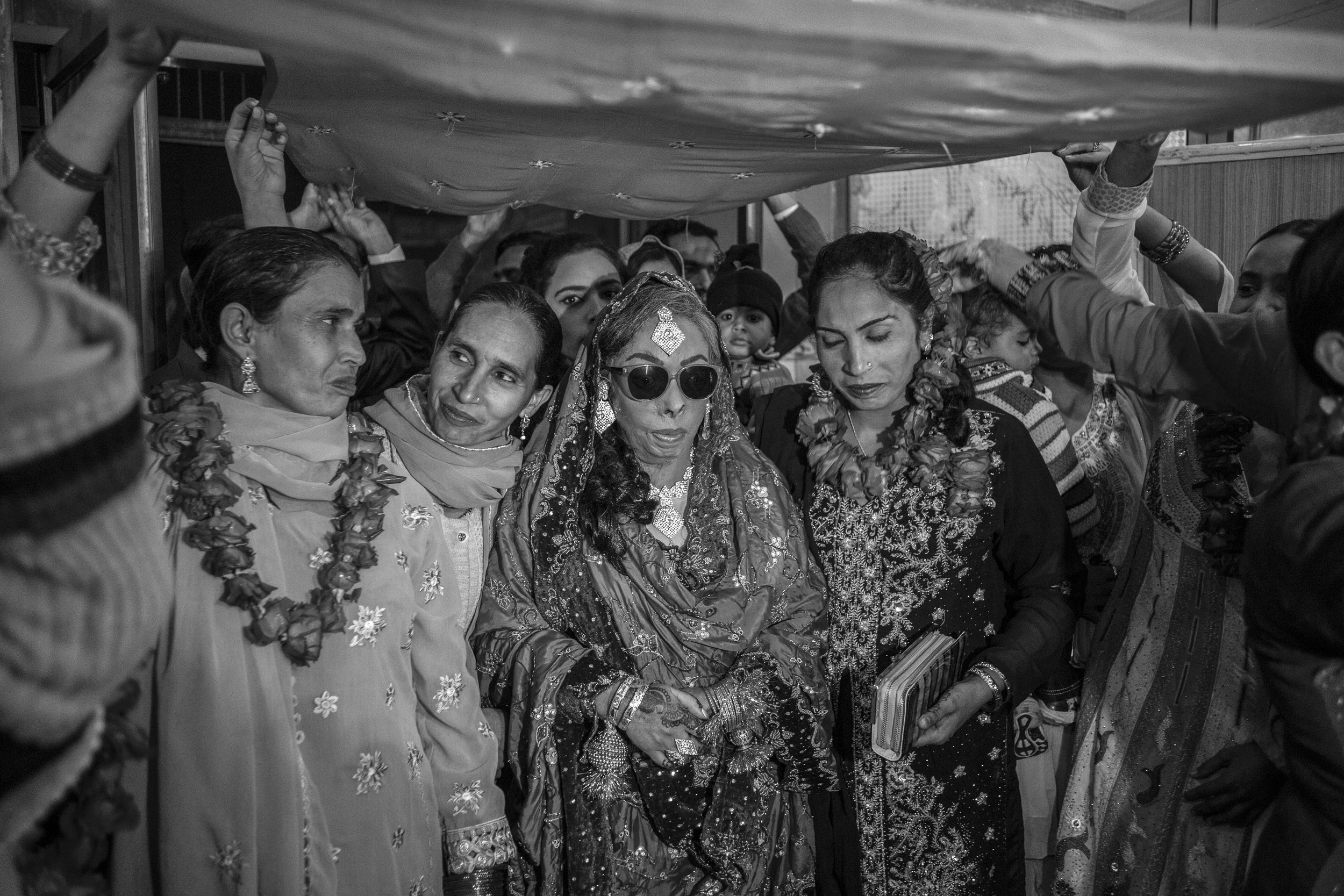 Sarwari Bibi and her sisters walk down the aisle at her wedding ceremony on Jan. 7, 2016 in Lahore, Pakistan.