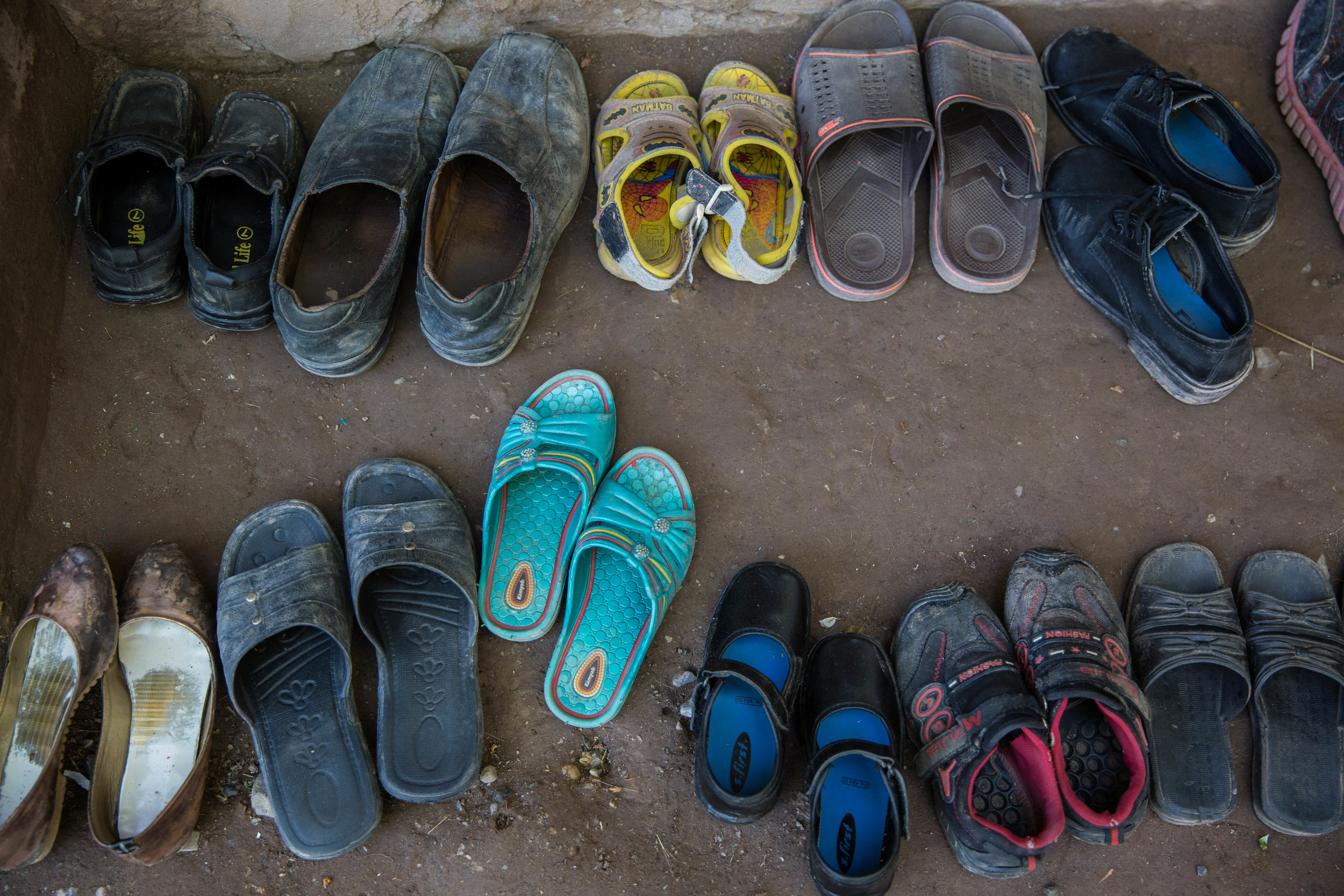 Young children from a remote village in Chitral leave their shoes outside for class at a Basic Education Community School on April 26, 2018 in District Chitral, Khyber Pakhtunkhwa, Pakistan.