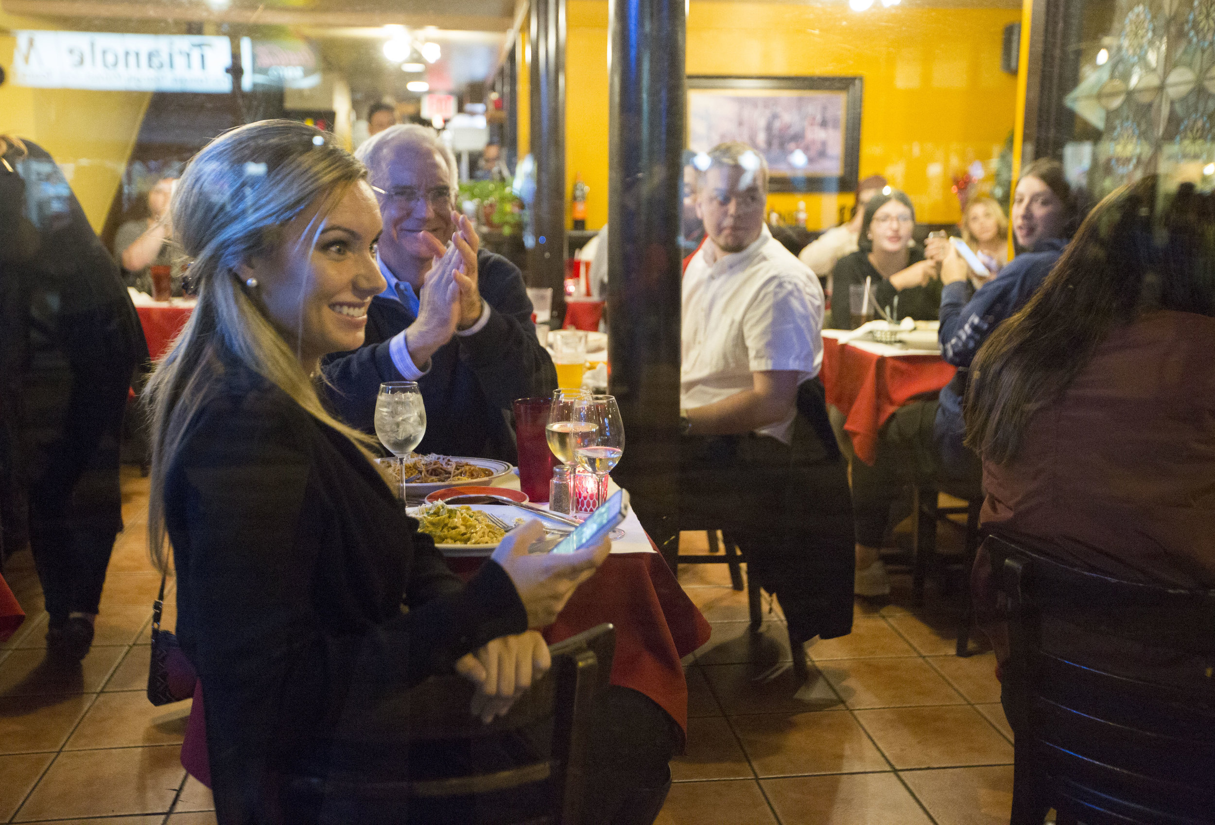 Onlookers inside a restaurant on State Street cheer for the protesters outside during an anti-Trump rally on Nov 10, 2016 in Madison, WI.