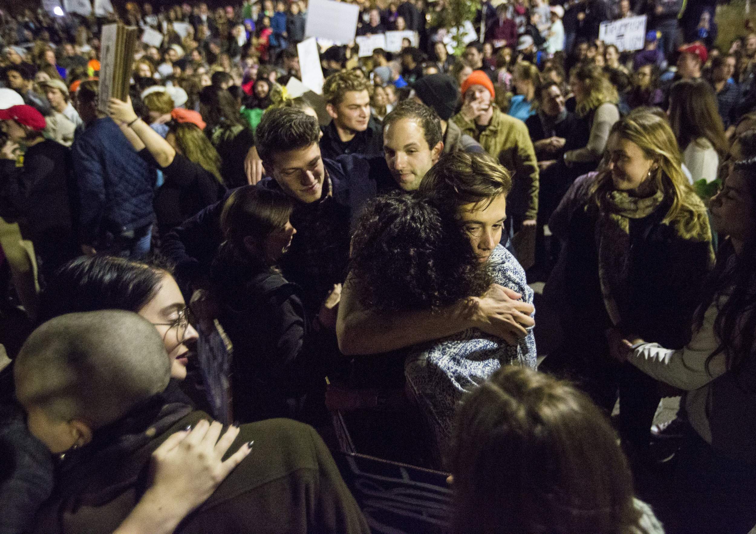 Protesters comfort each other with hugs during an anti-Trump rally on Nov 10, 2016 in Madison, WI.