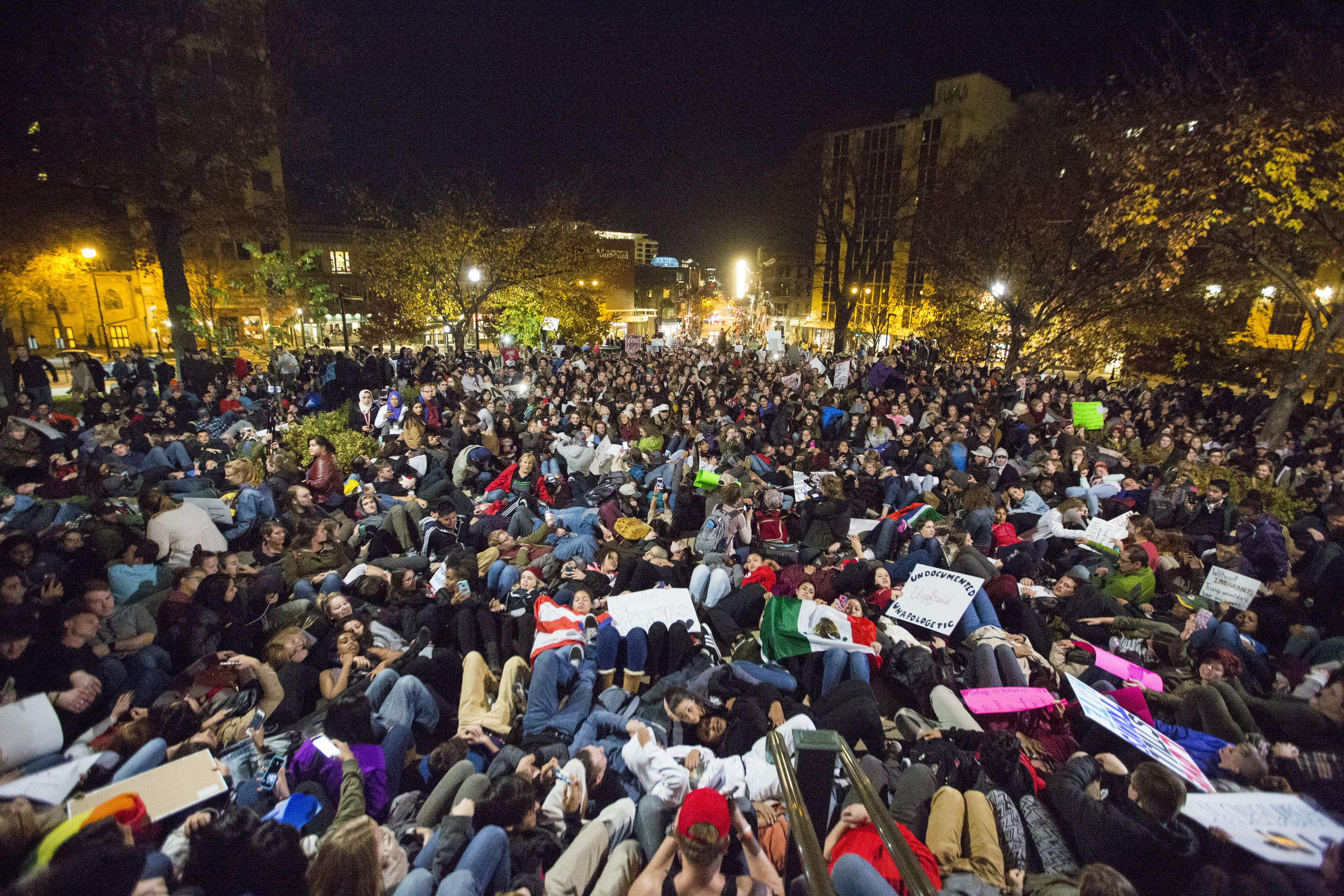 Protesters lay down outside the Capitol building for a moment of silence during an anti-Trump rally on Nov 10, 2016 in Madison, WI.