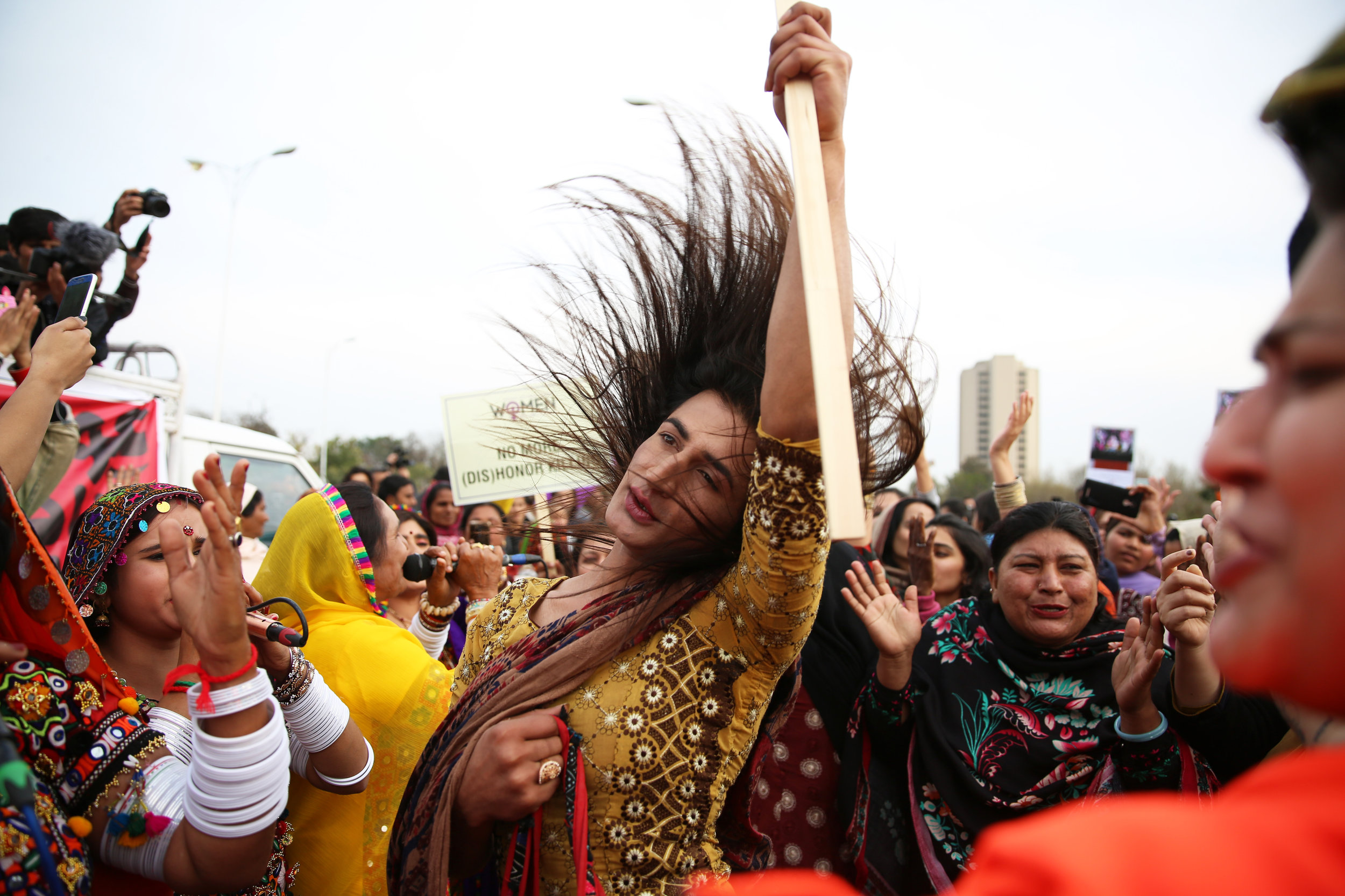 Julie Aman, a transgender dances to a folk band at the Aurat March event celebrating International Women's Day in Islamabad, Pakistan, March 8, 2019.