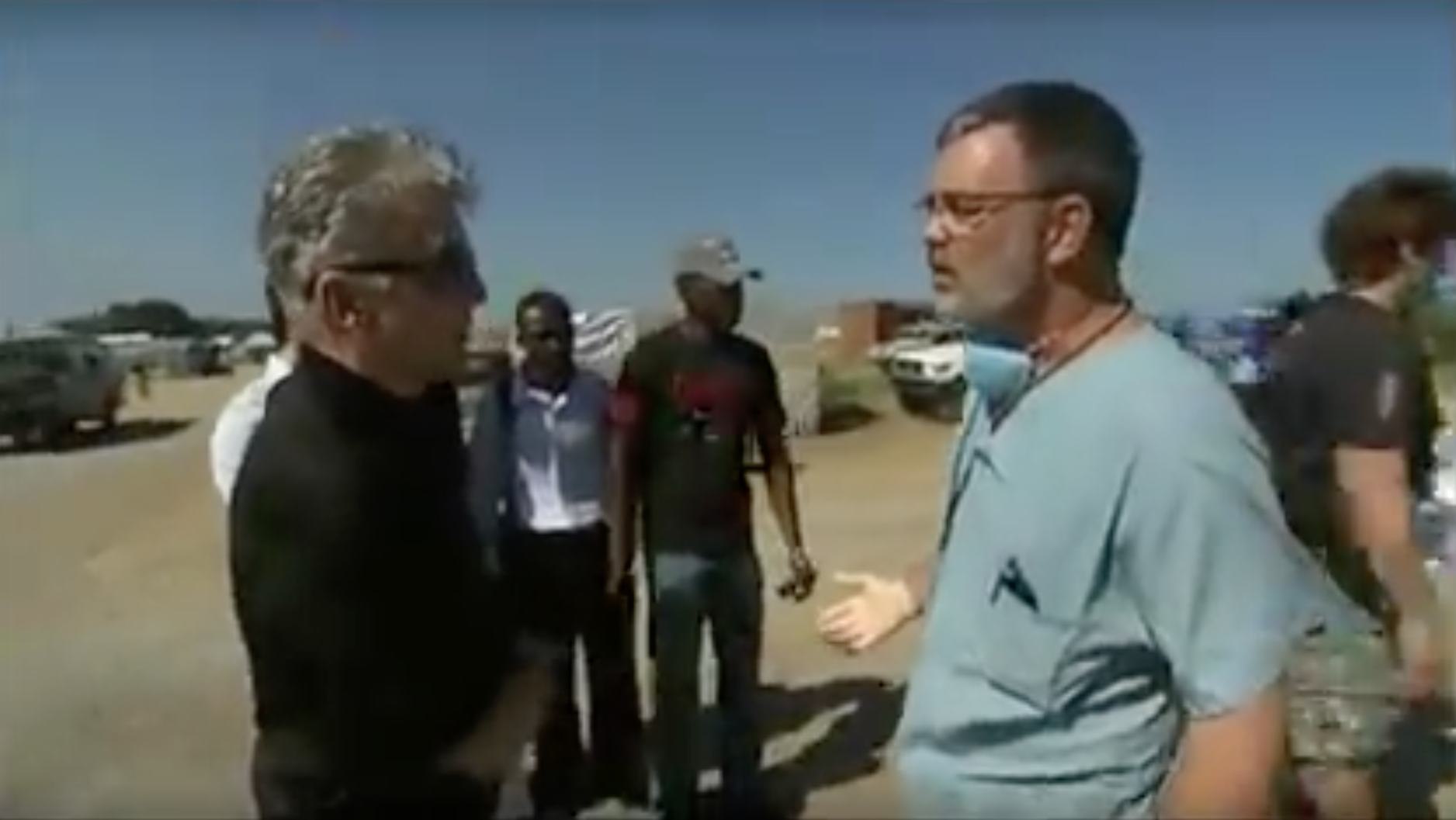 Kurt Holthus talking with John Walsh
