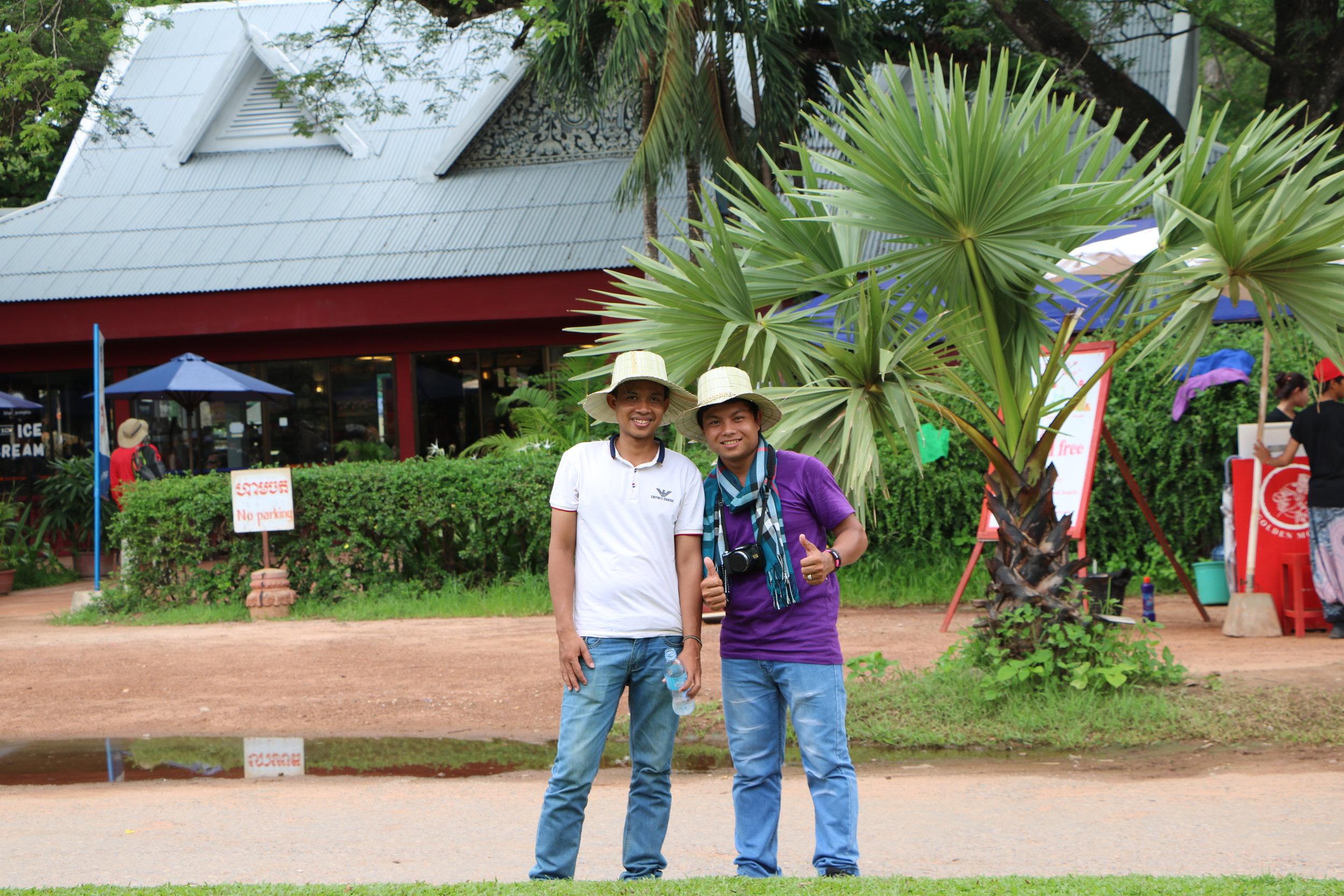 Teacher Samnieng and Teacher Samath visiting Angkor Wat, 2016.