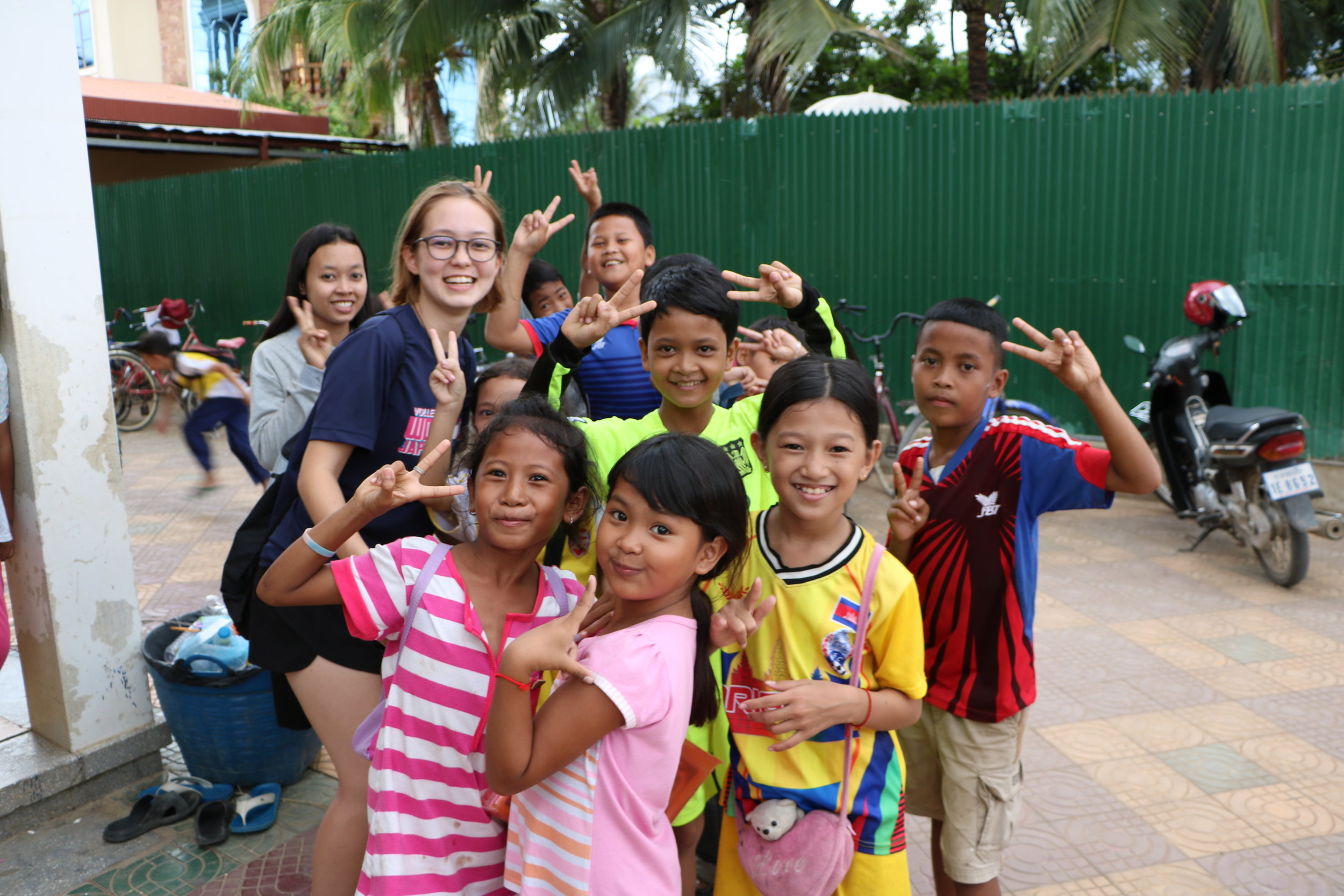 Volunteer Shima Langan with her students at the Rattinak TASSEL School on her trip in the summer of 2016.