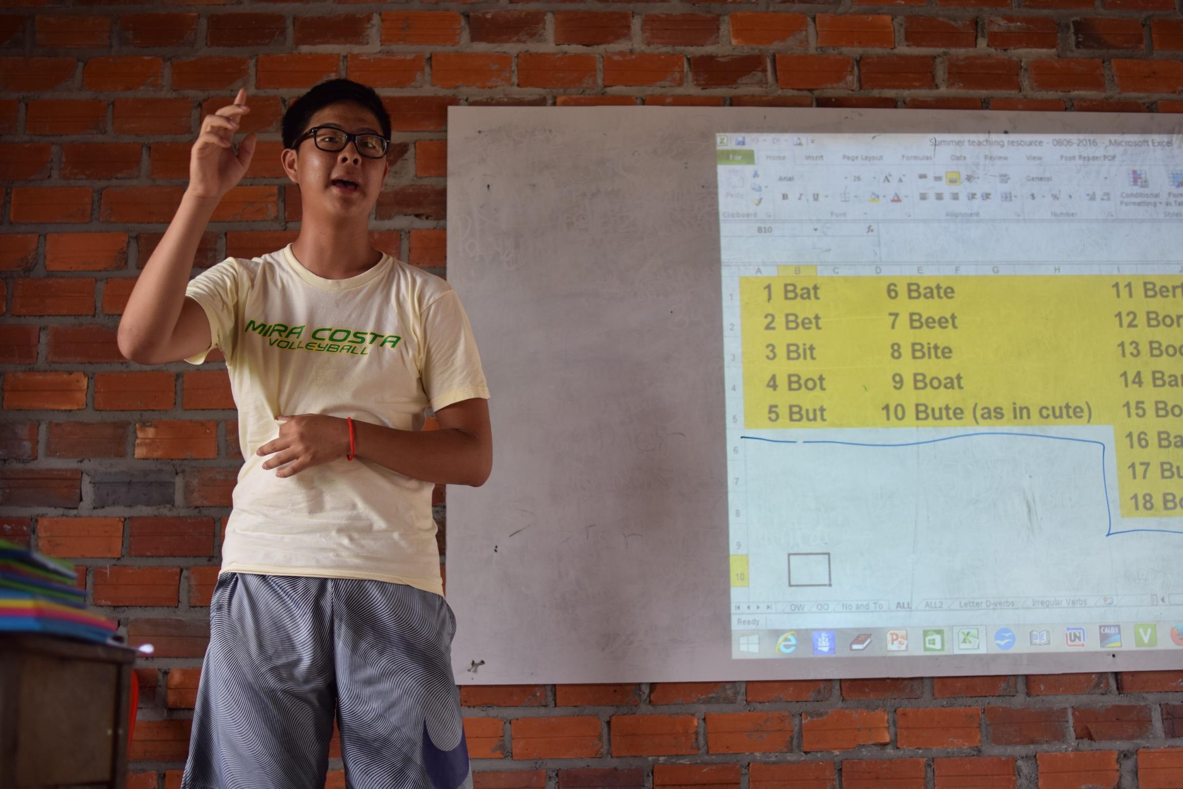Adam Kim teaching before a classroom of students in Samrang during a 2016 TASSEL summer trip.