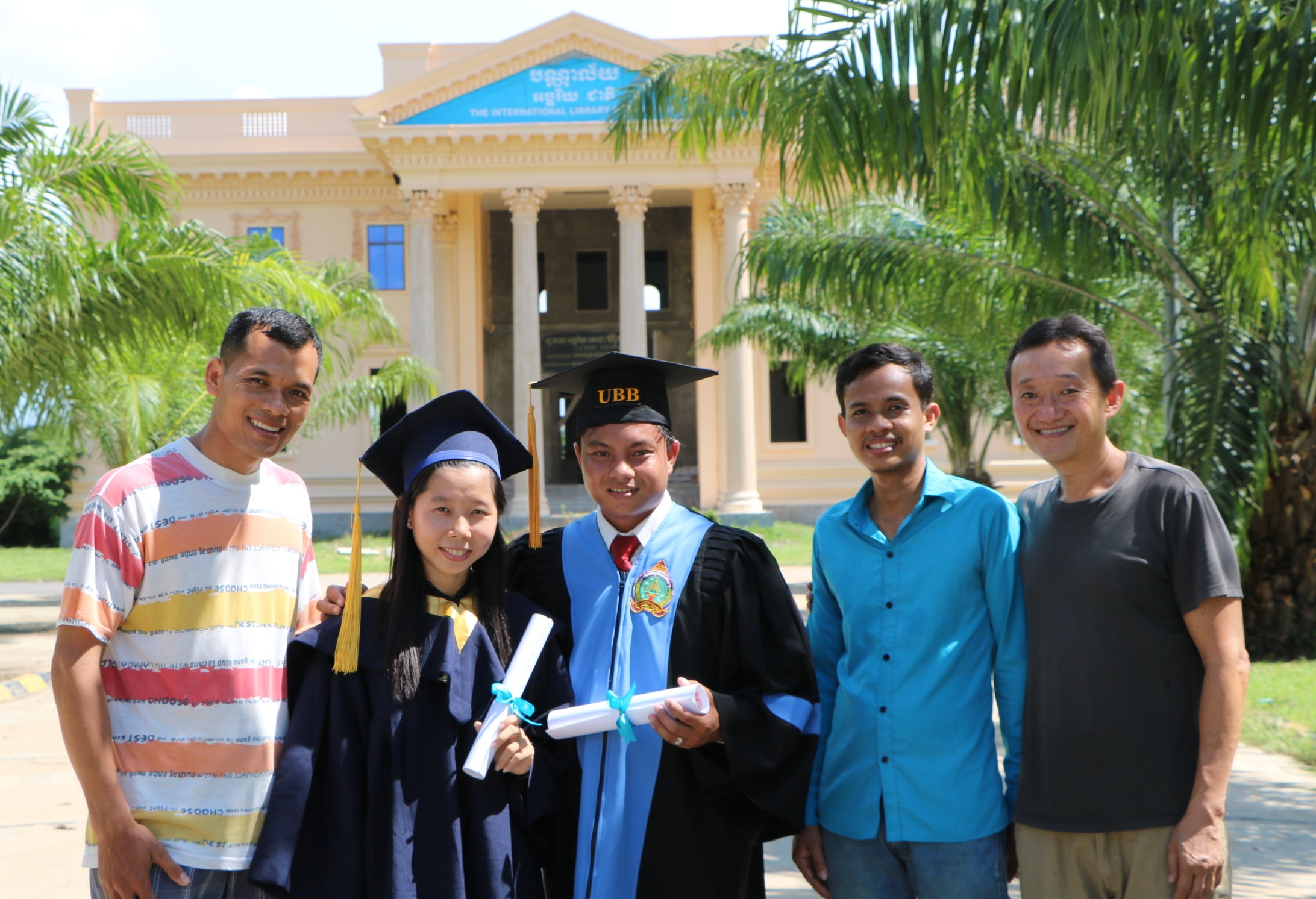 Local teachers Noeng, Naihuoy, Samath, and Samnieng with Joji Tatsugi celebrating the graduation of two teachers from University of Battambang, 2016.