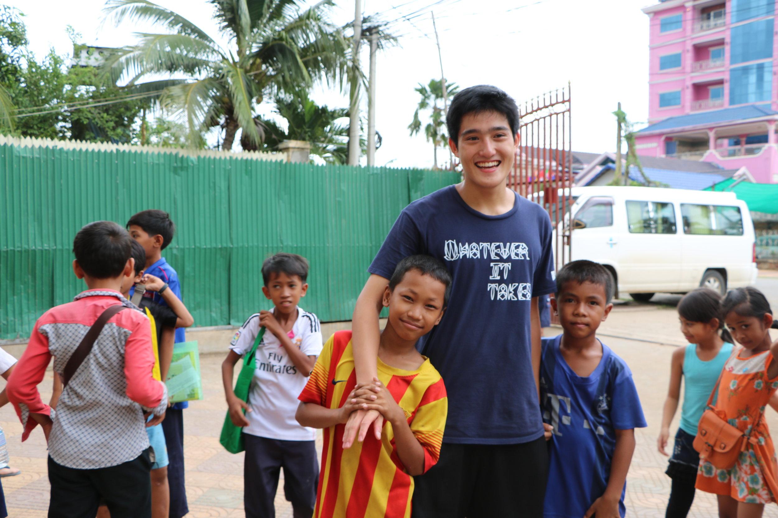 TASSEL volunteer Wilson Zhang with his students at the Rattinak TASSEL School, 2016.