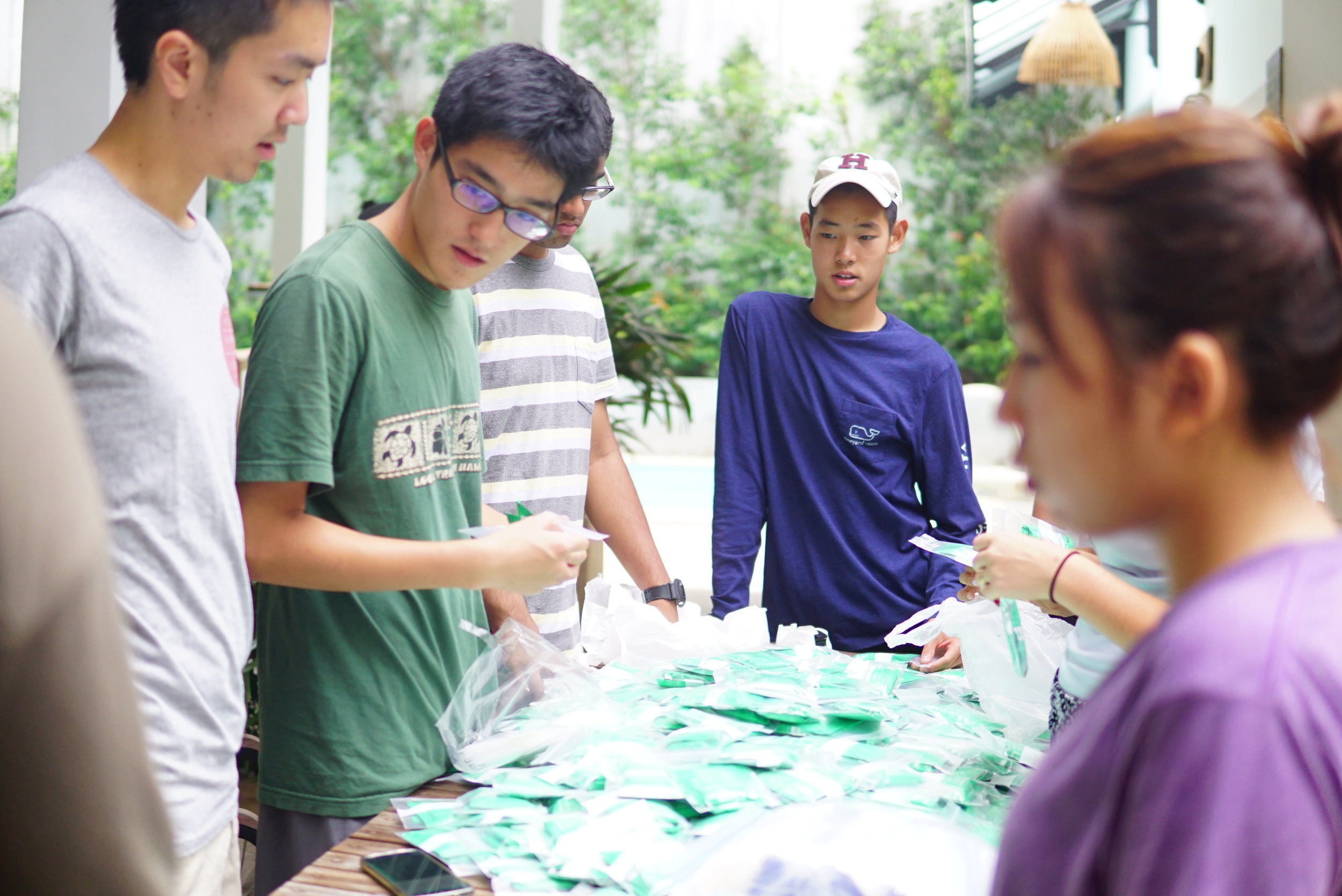 Wilson sorting medicine to be distributed to children and villagers of the TASSEL community.