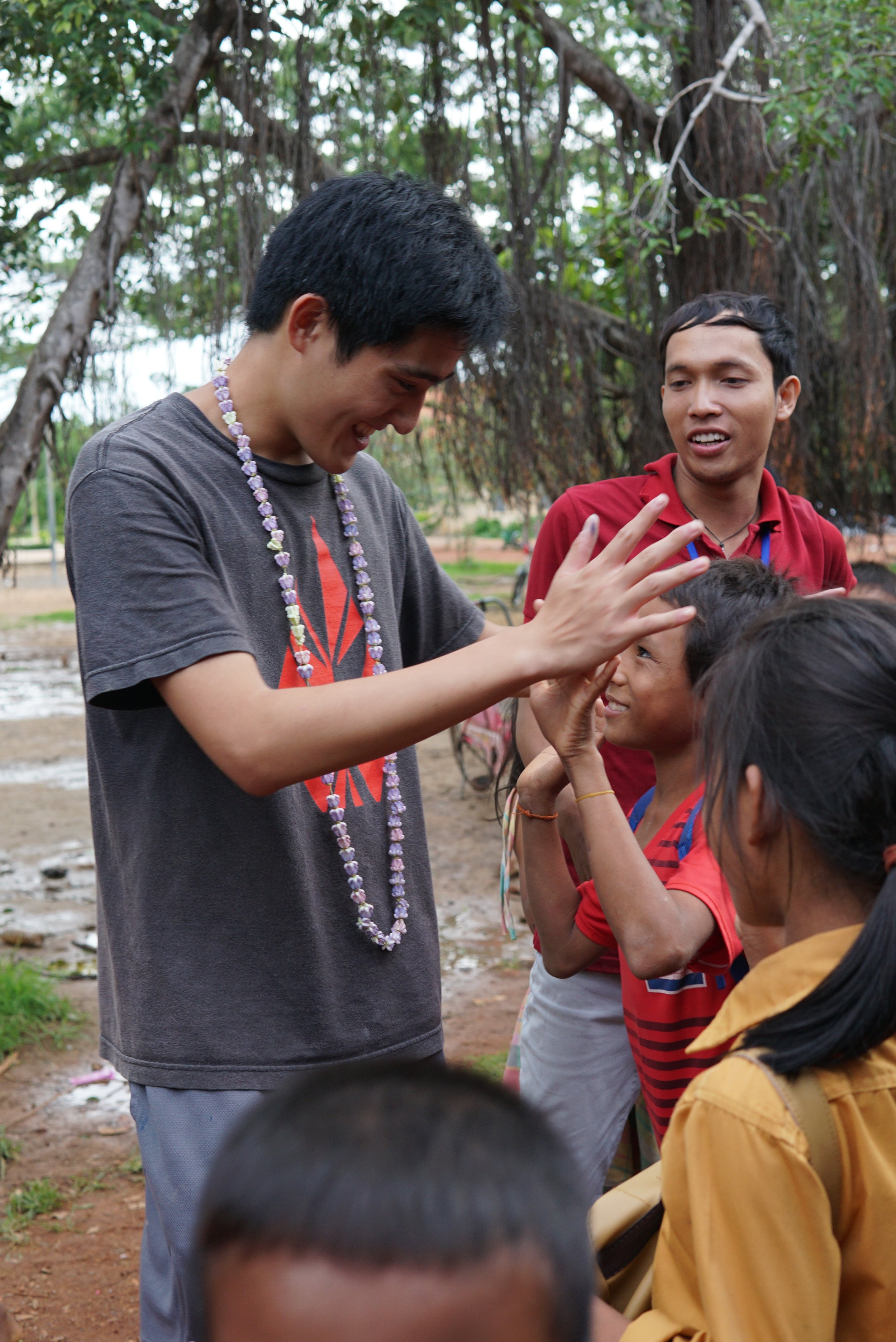 Wilson greeting his students at the Banan TASSEL School, 2016.