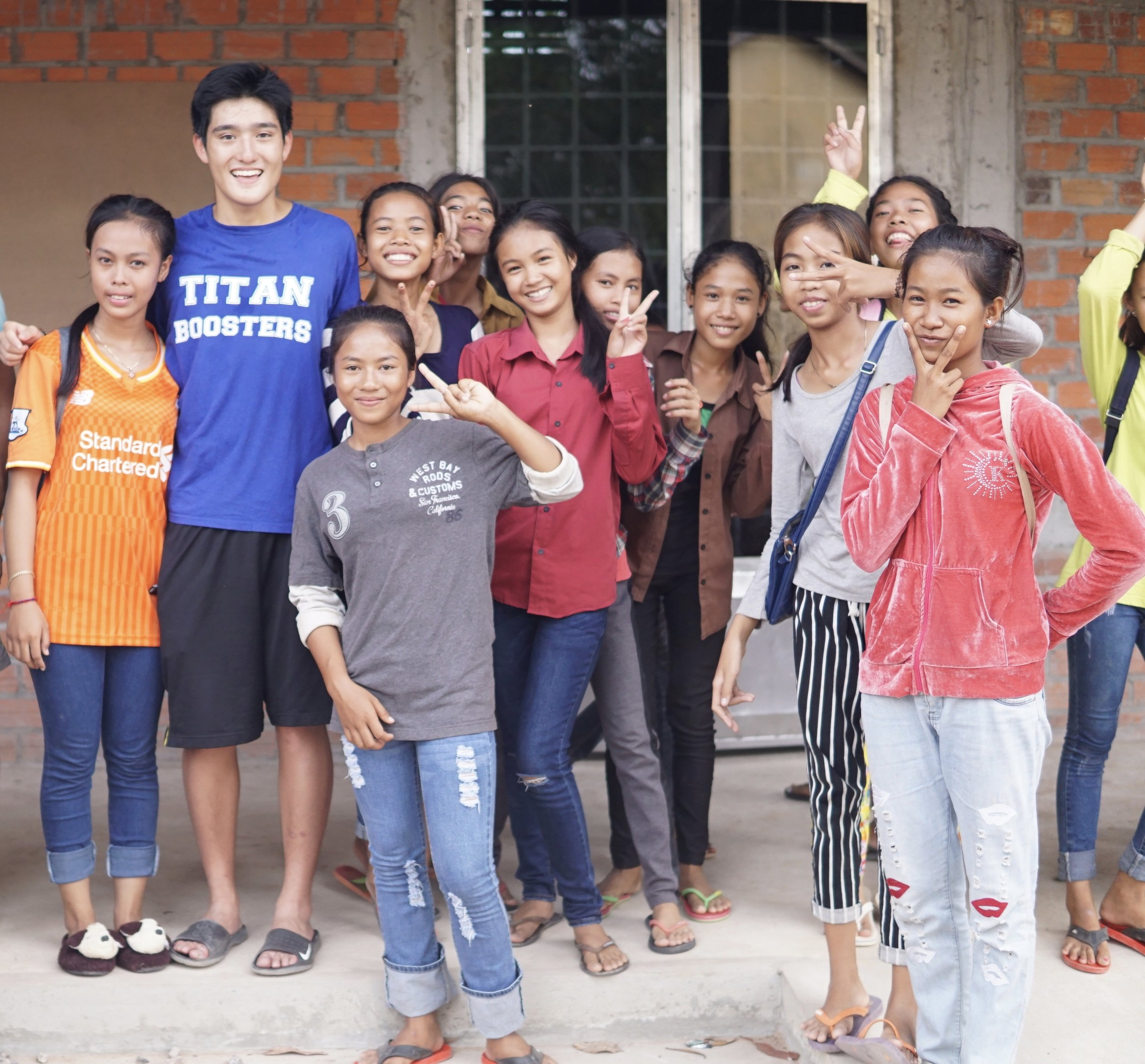 Wilson with students of the Samrang TASSEL School, 2016.