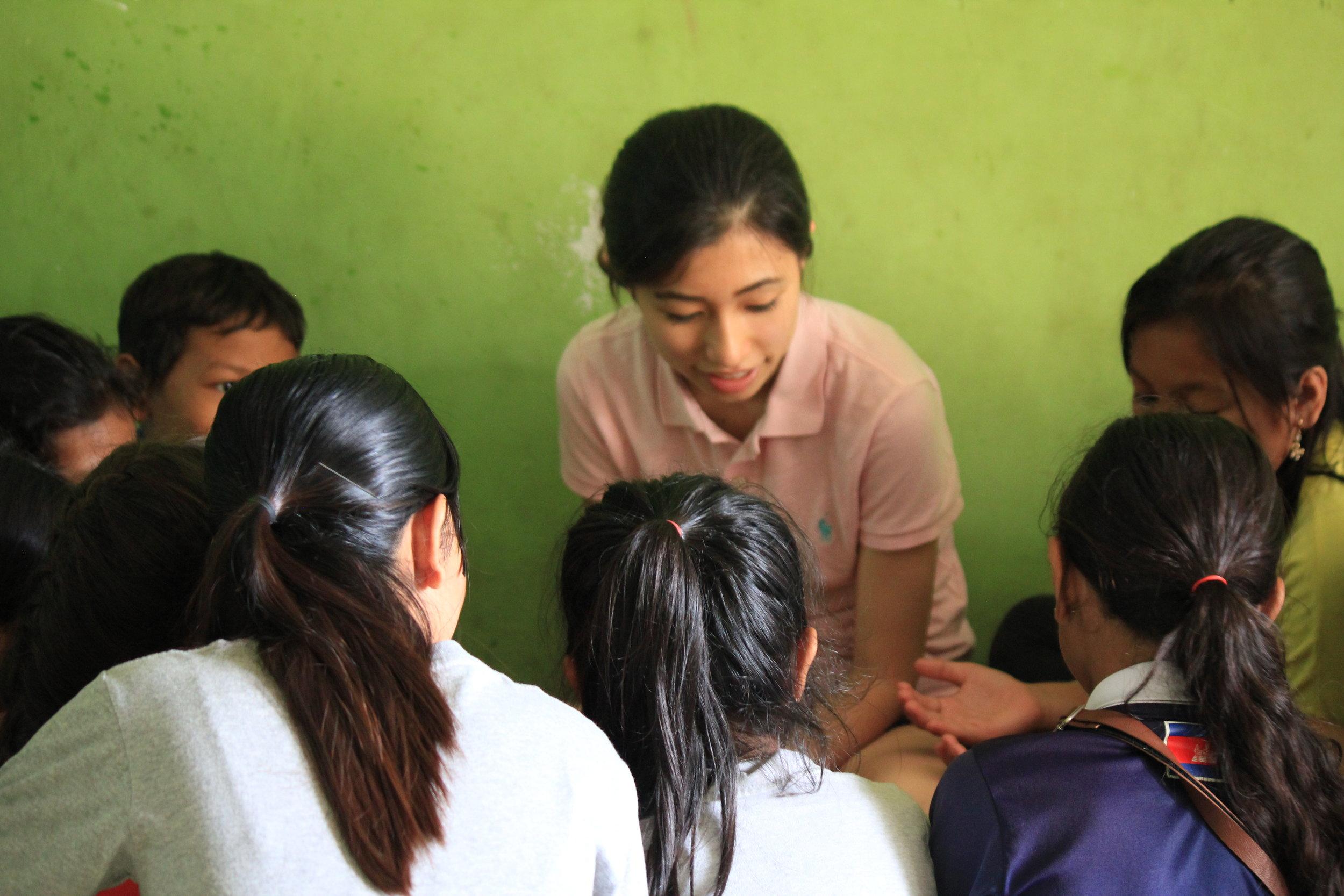 Maria with TASSEL students in Samrang village.