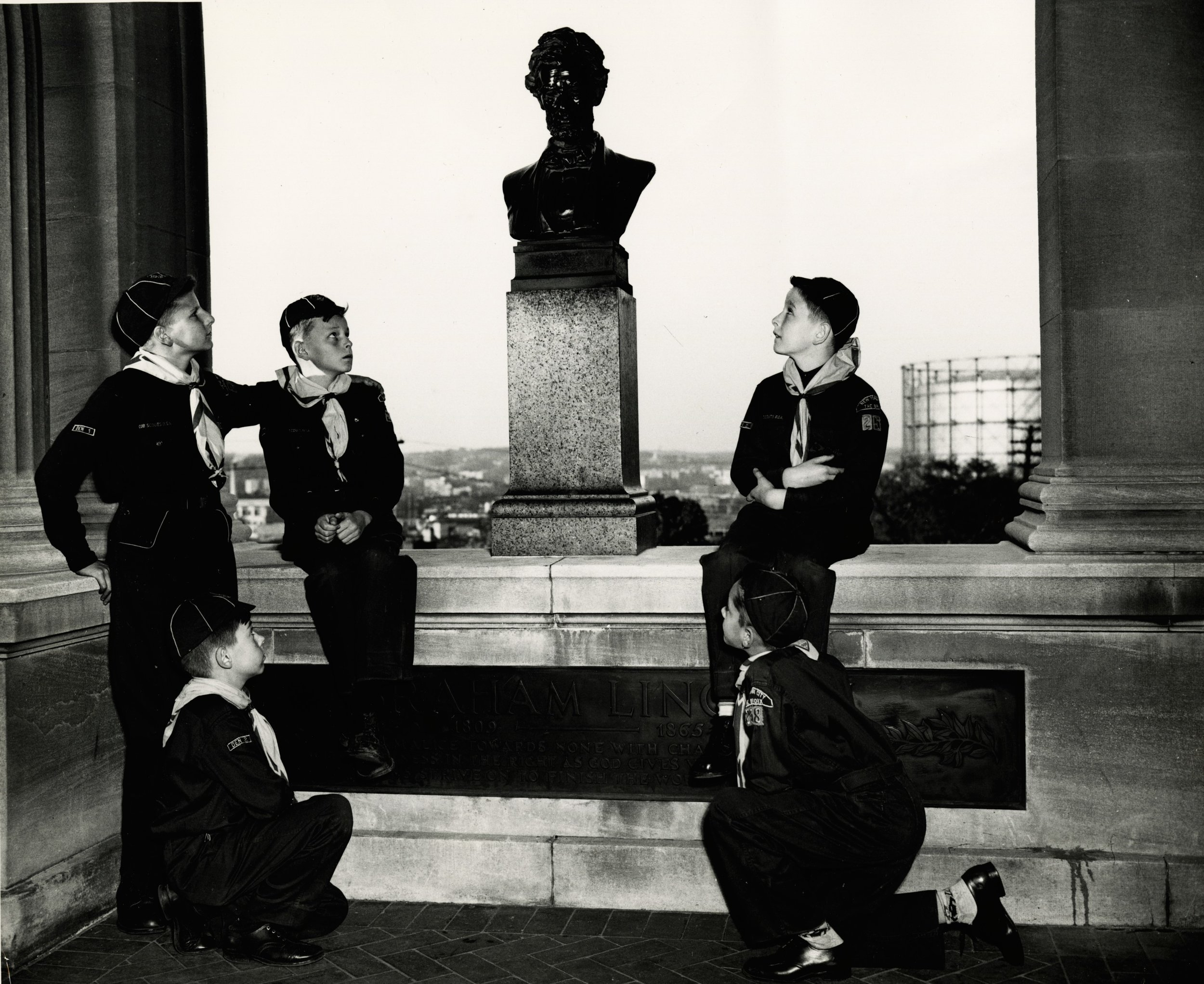 Boy scouts admire the bust of Abraham Lincoln in an undated photograph.