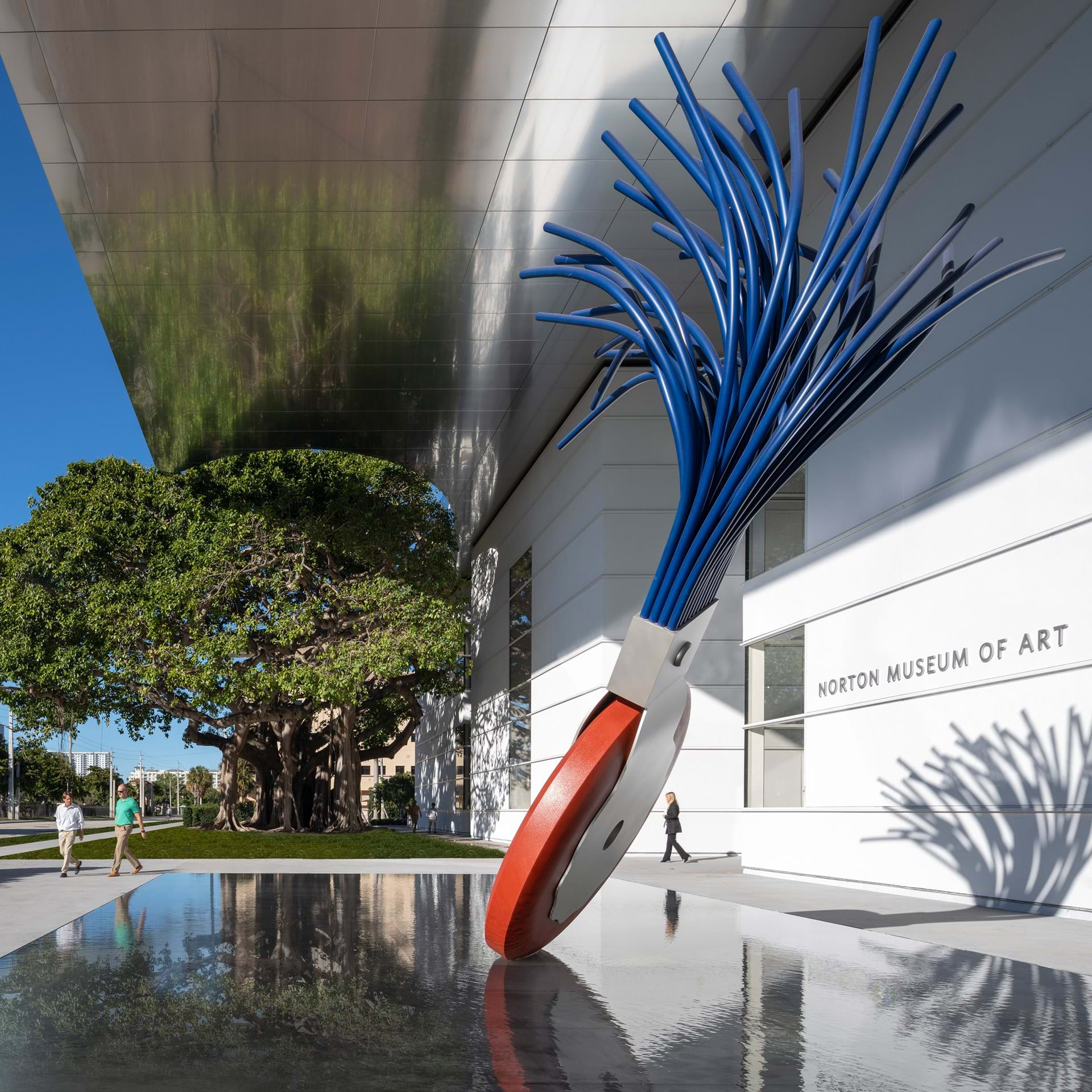 Typewriter Eraser, Scale X (1999) by Claes Oldenburg and Coosje van Bruggen (foreground) and the banyan tree in front of the Norton Museum of Art. Photo: Nigel Young.