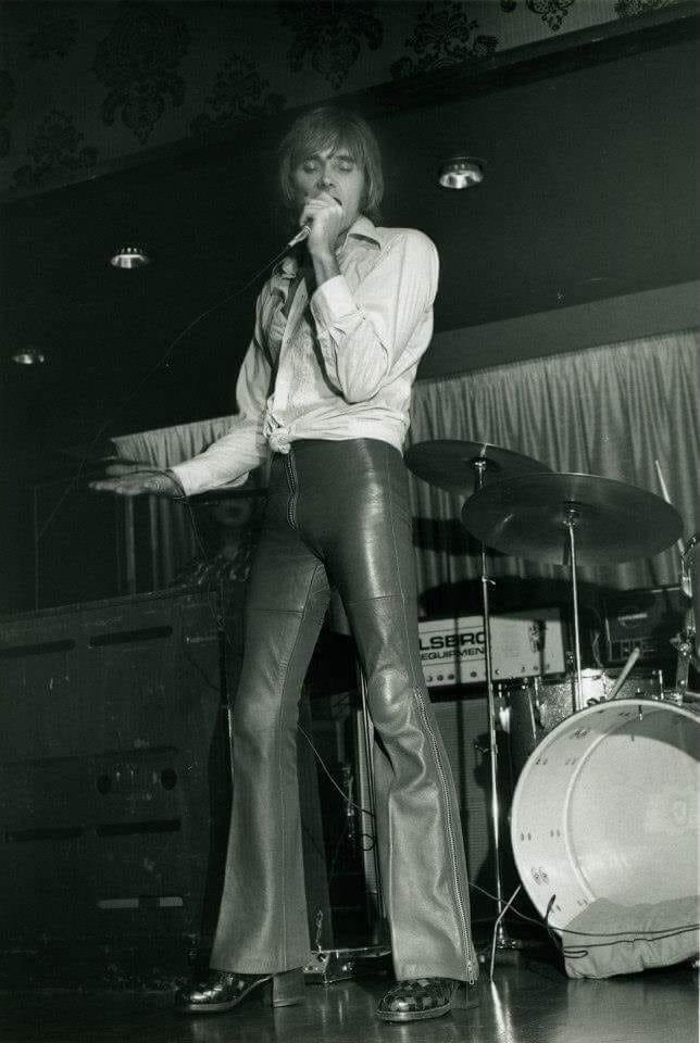 - Billy in his leather trousers and shirt knotted at the waist.