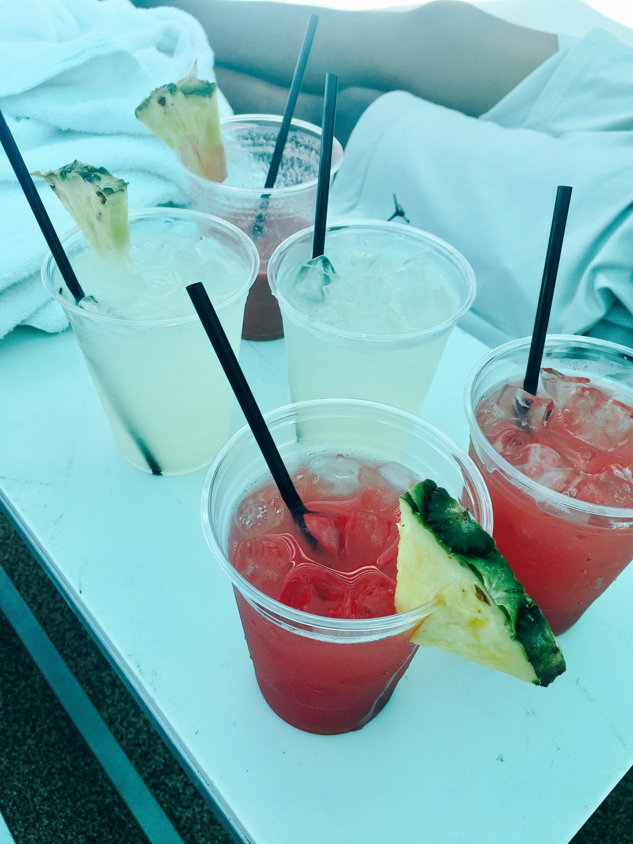 Fresh Watermelon juice topped with a pineapple slice and iced cold lemonade for hot days. YUM!