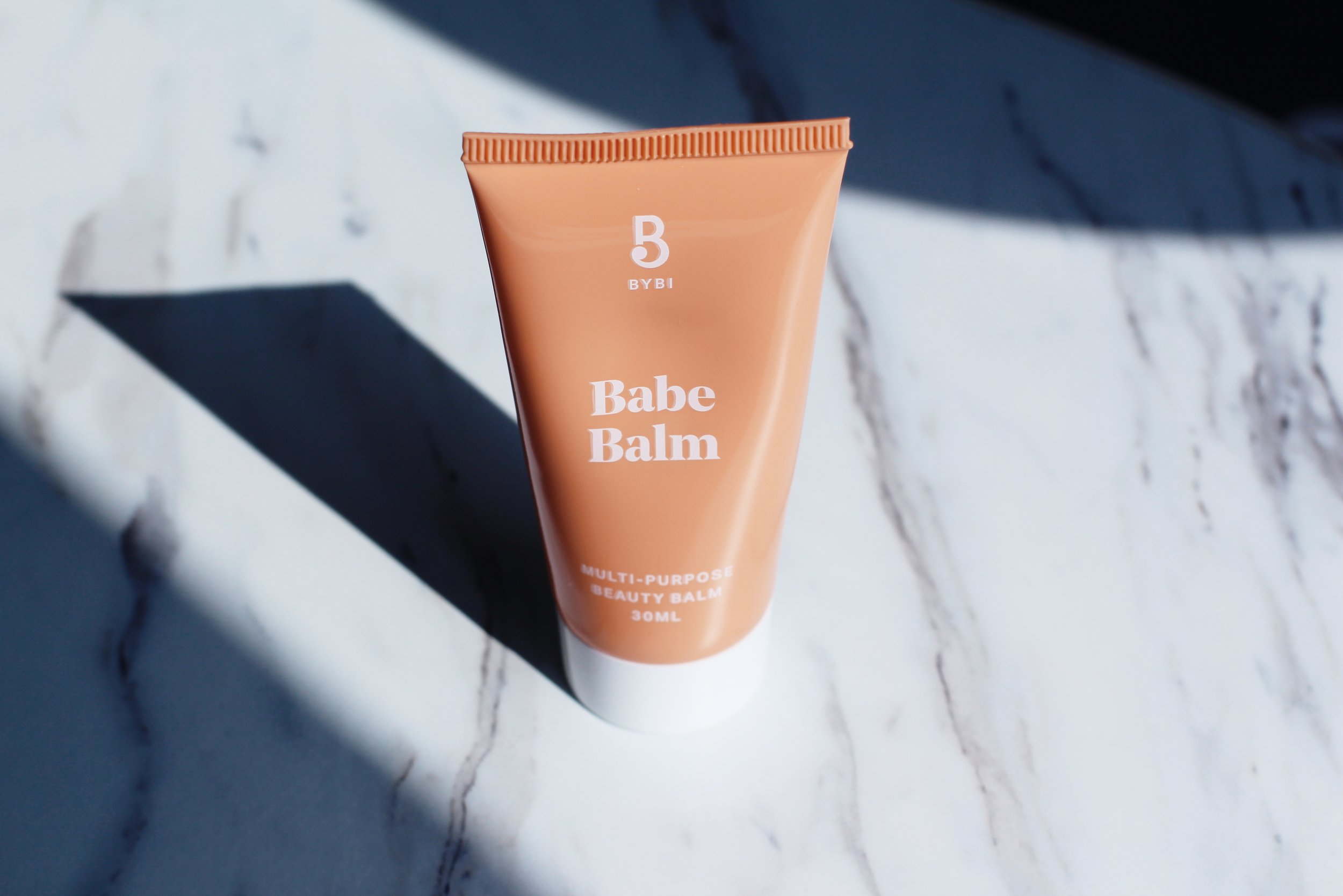 """BABE BALM-MULTI-PURPOSE BEAUTY BALM  TOP 3 USES:  NIGHT CREAM- essential for the face, neck, and chest. Include this in your night routine for super soft and rejuvenated skin.  DEHYDRATION TREATMENT- replenishes areas of the skin that are dry and/or cracked.""""Calendula and hibiscus get to work on dry legs, hands, feet, elbows, knees, bums and tums.""""  HIGHLIGHT ON FLEEK- use this on your cheeks on on the brow bone for an instant natural glow or highlight. Apply to lips or eyelids for a glossy effect. """"It's dreamy creamy texture means you can even mix with your mineral makeup to create bespoke blushes and stains."""""""