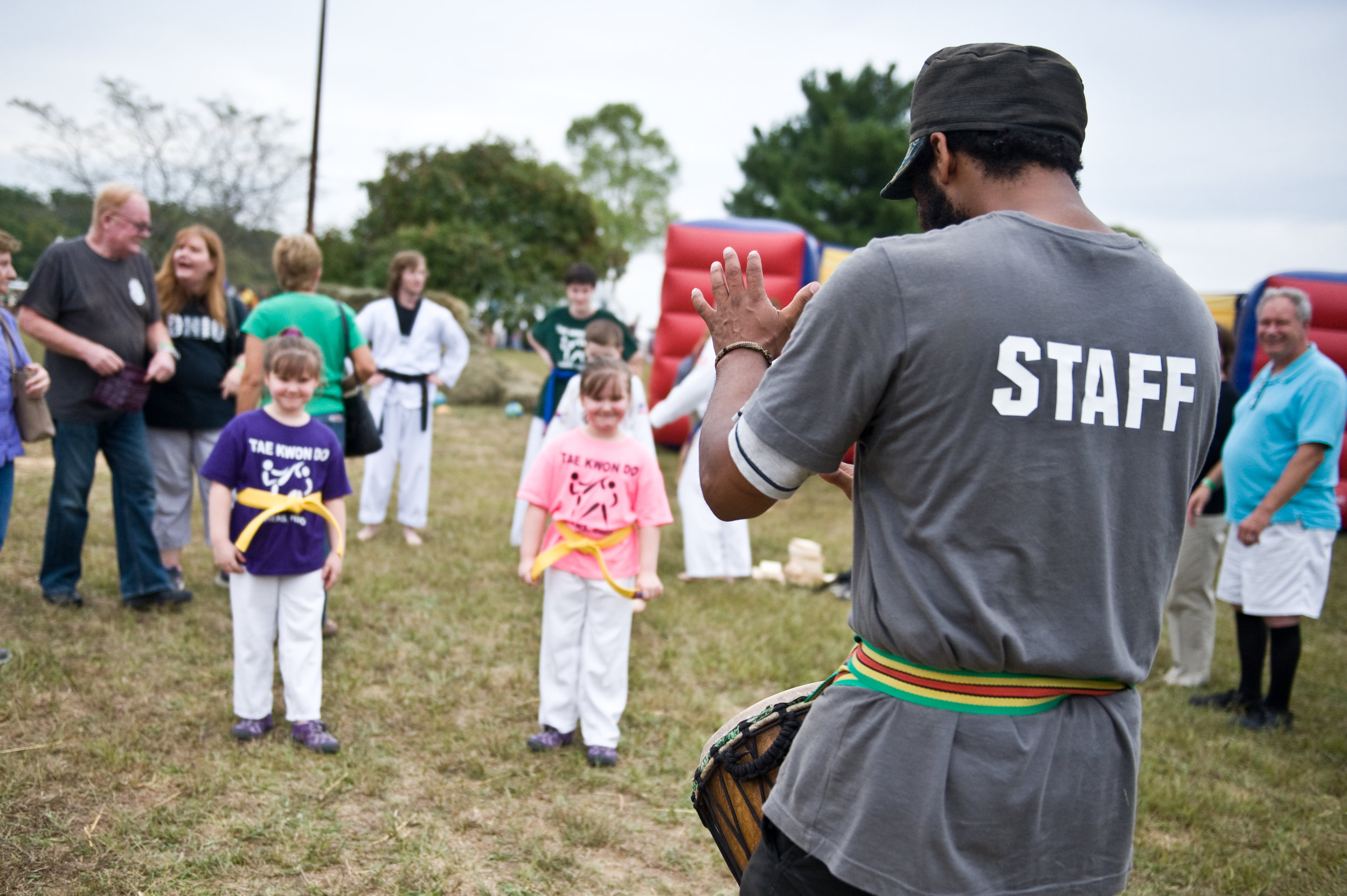 Lawrence Green, drumming the crowd together for the festival's Tae Kwan Do demonstration. Lawrence is part of the  RAW (Rising Appalachian Warriors)  program, which has summer camps for kiddos, and also hosted the kids' tent at the fest.Photo by  Michelle Waters