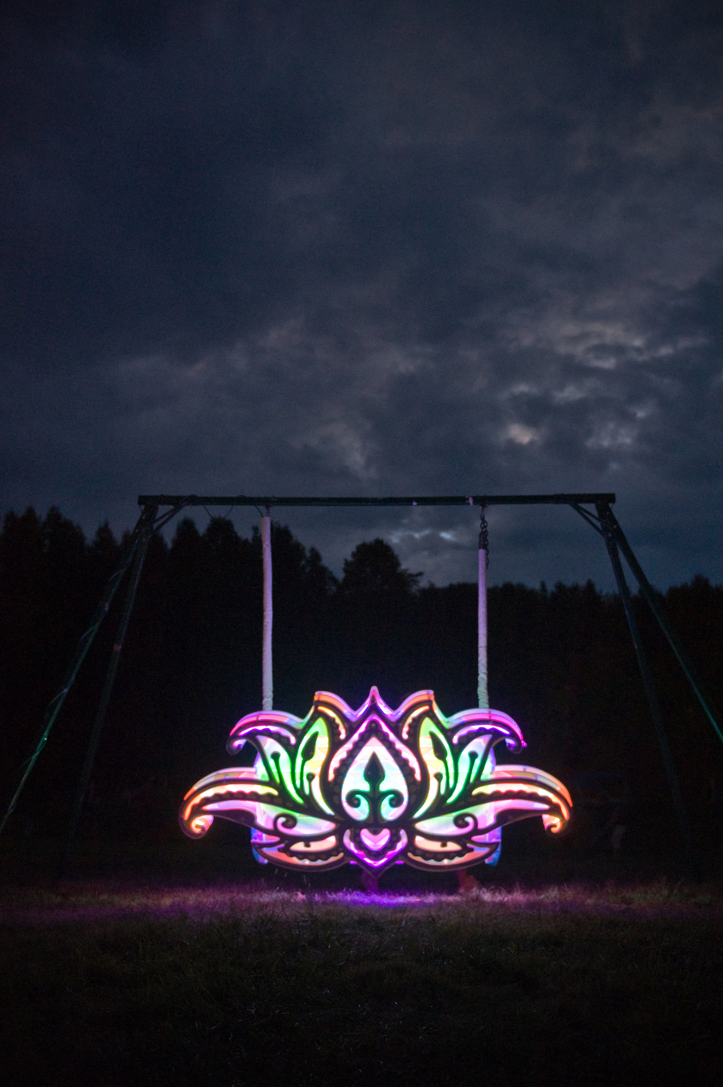 When you go next year, be sure to look for cool, interactive artwork like this rainbow swing. Here you can listen to the music gently roll over your ears while you sway back and forth, staring at the sky...photo by  Michelle Waters.