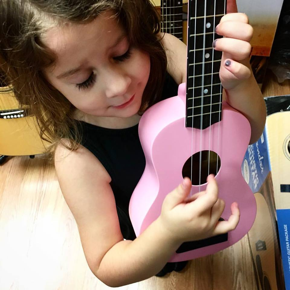 Ukuleles are the perfect size for kiddos of all ages.