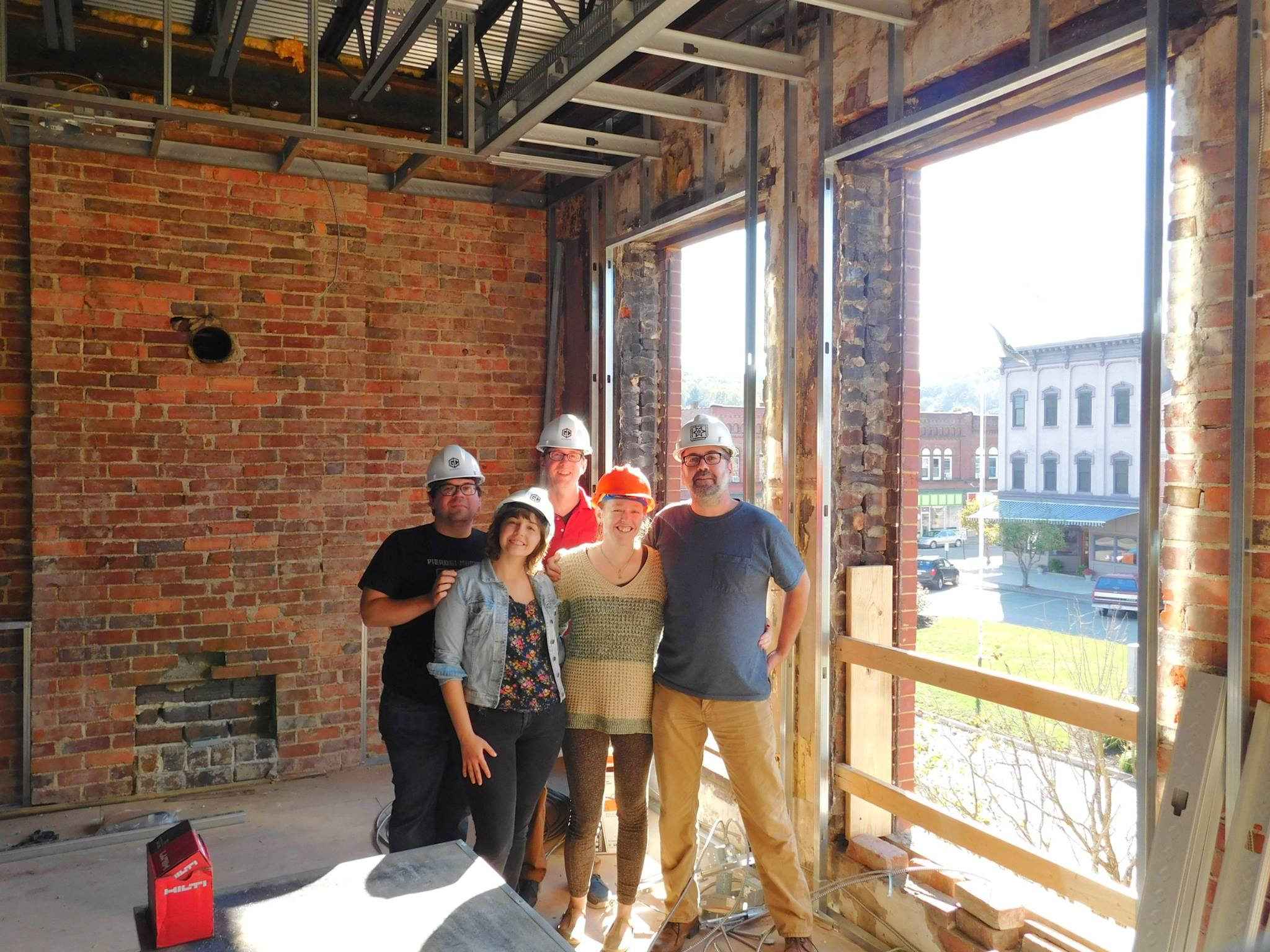 The team at Stuart's Opera House pose for a quick photo in the midst of the construction on this impressive project. Photo provided by Stuart's Opera House.