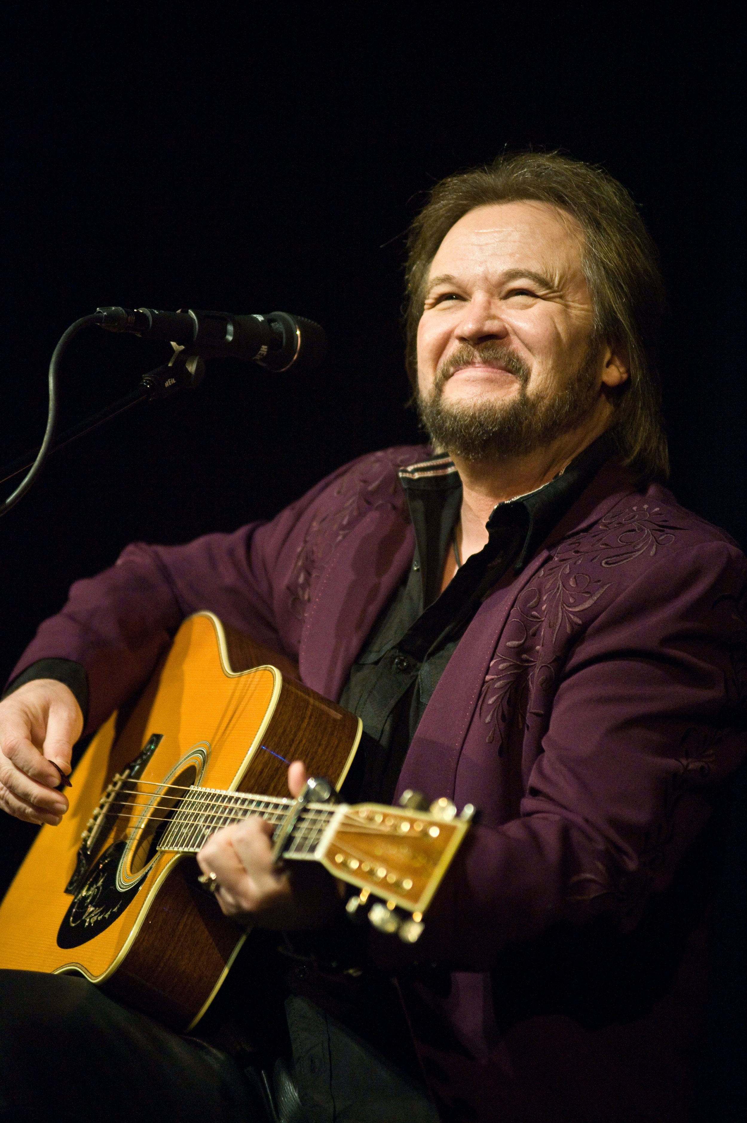 Travis Tritt  returns to town, stopping at Charleston's  Clay Center  this coming Friday. Photo, from Marietta, Ohio's  Peoples Bank Theatre' s opening weekend, by  Michelle Waters .