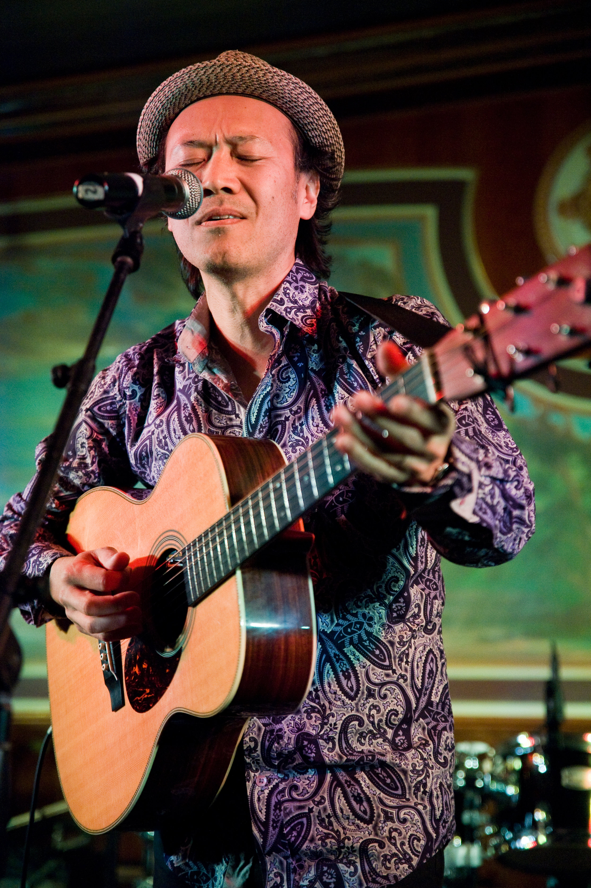 """Satoru Nakagawa, of the  Tokyo Tramps , opened his set with a haunting rendition of  Skip James '  """"Hard Time Killin' Floor"""" . Photo by  Michelle Waters ."""