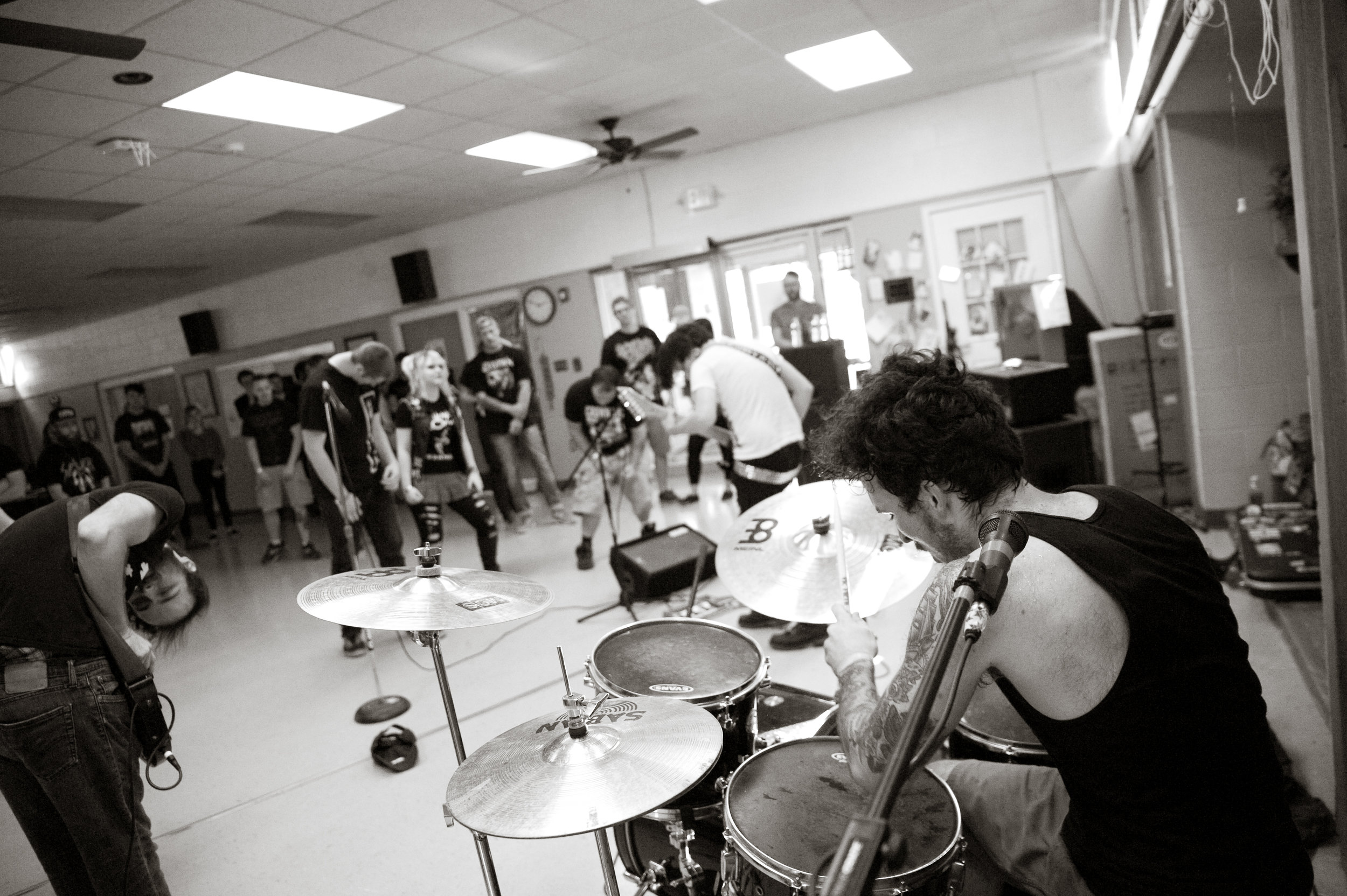 Lane Hughes playing drums for Crown Vic. All band photos in article by Michelle Waters.