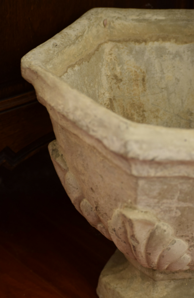 An old cement urn looks like a piece of art.