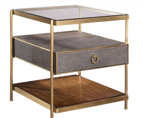Here is another example of a more modern end table that has three different types of materials for shelving, glass, Shagreen, and wood all held together in a brass frame.
