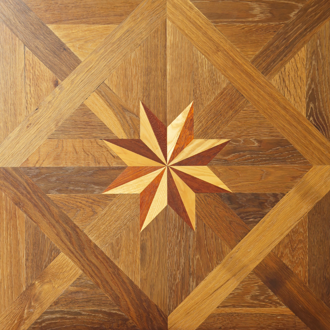 This is an example of a hardwood parquetry pattern. This particular example has the added decoration in the center which you may not see in other examples.