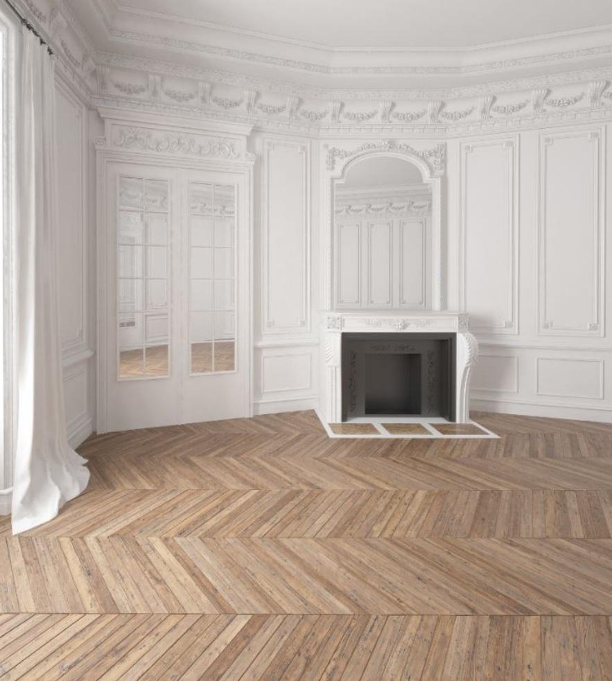 Herringbone wood flooring pattern in this French living room.