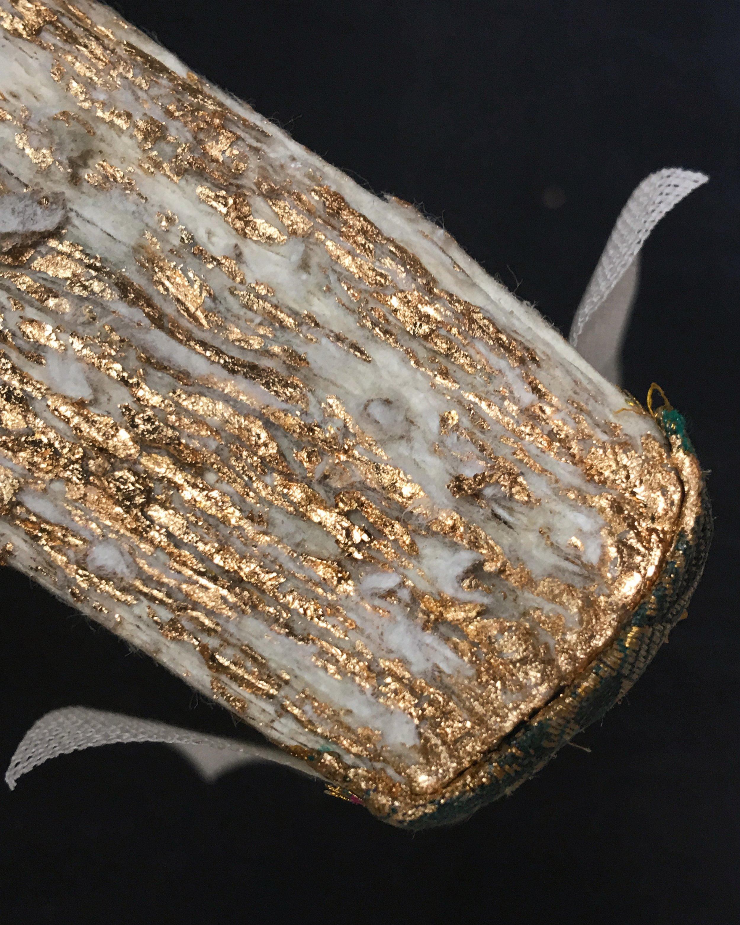 Gold leaf gilding on deckled edges wasn't easy