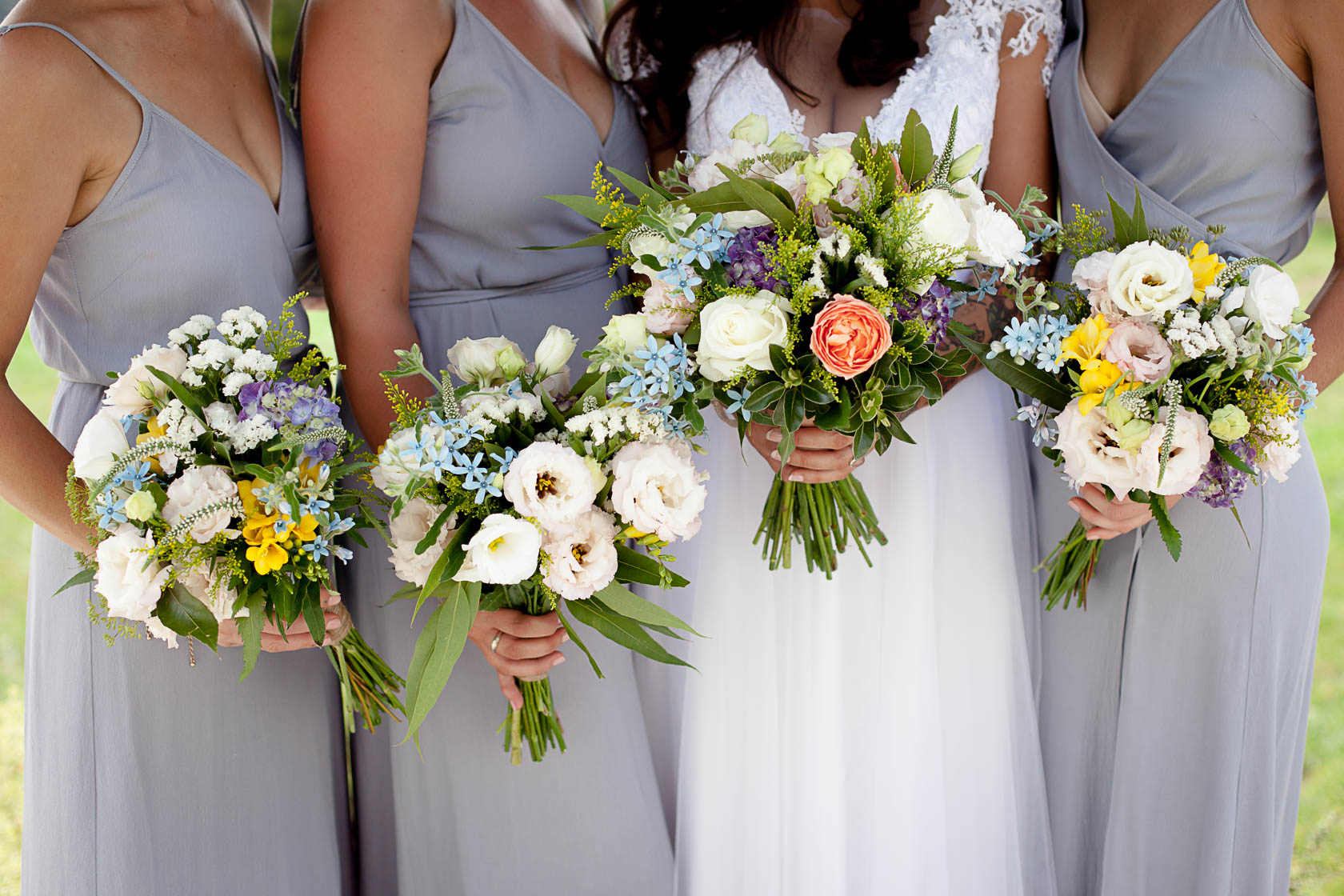Bridesmaids and bride with close up of flowers