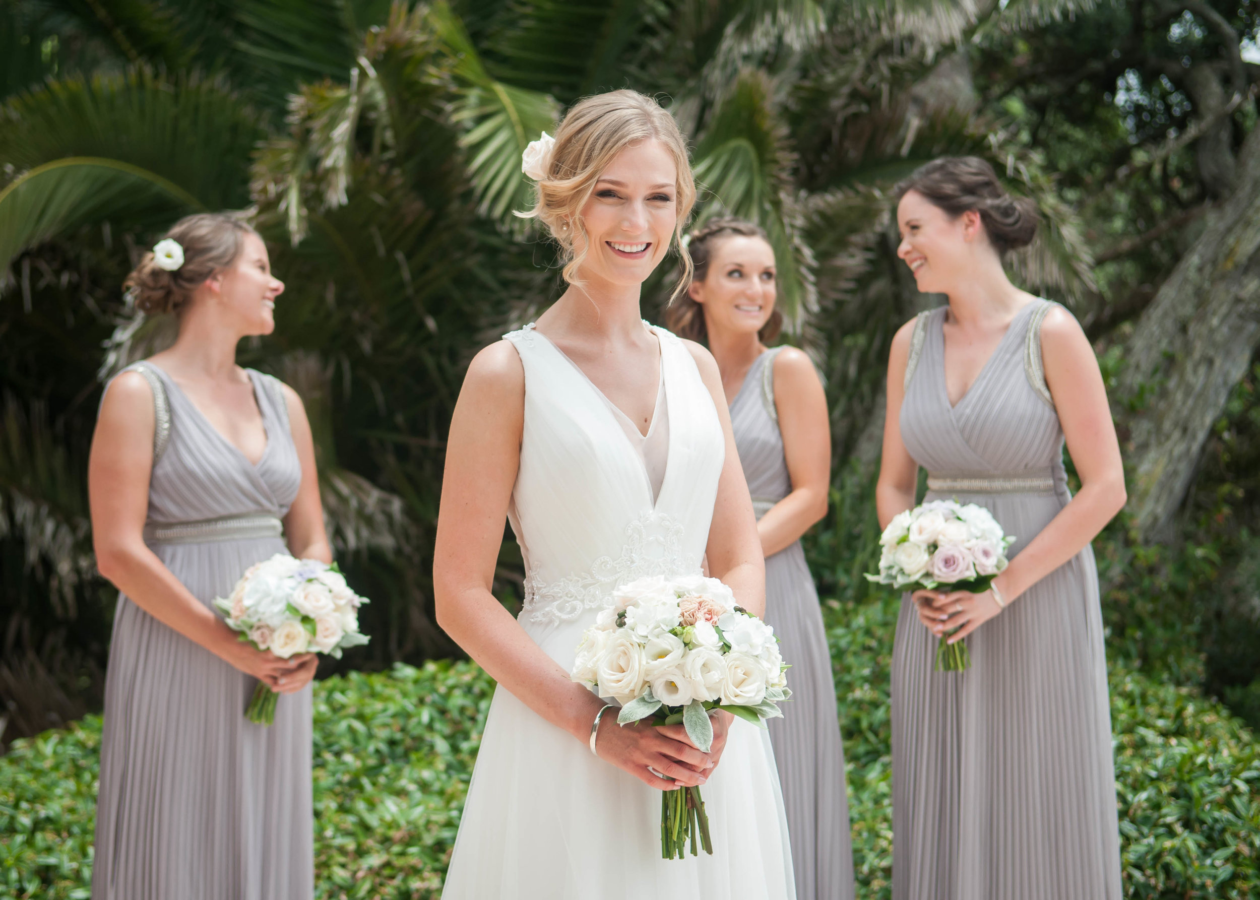 Smiling bride with bridesmaids in background