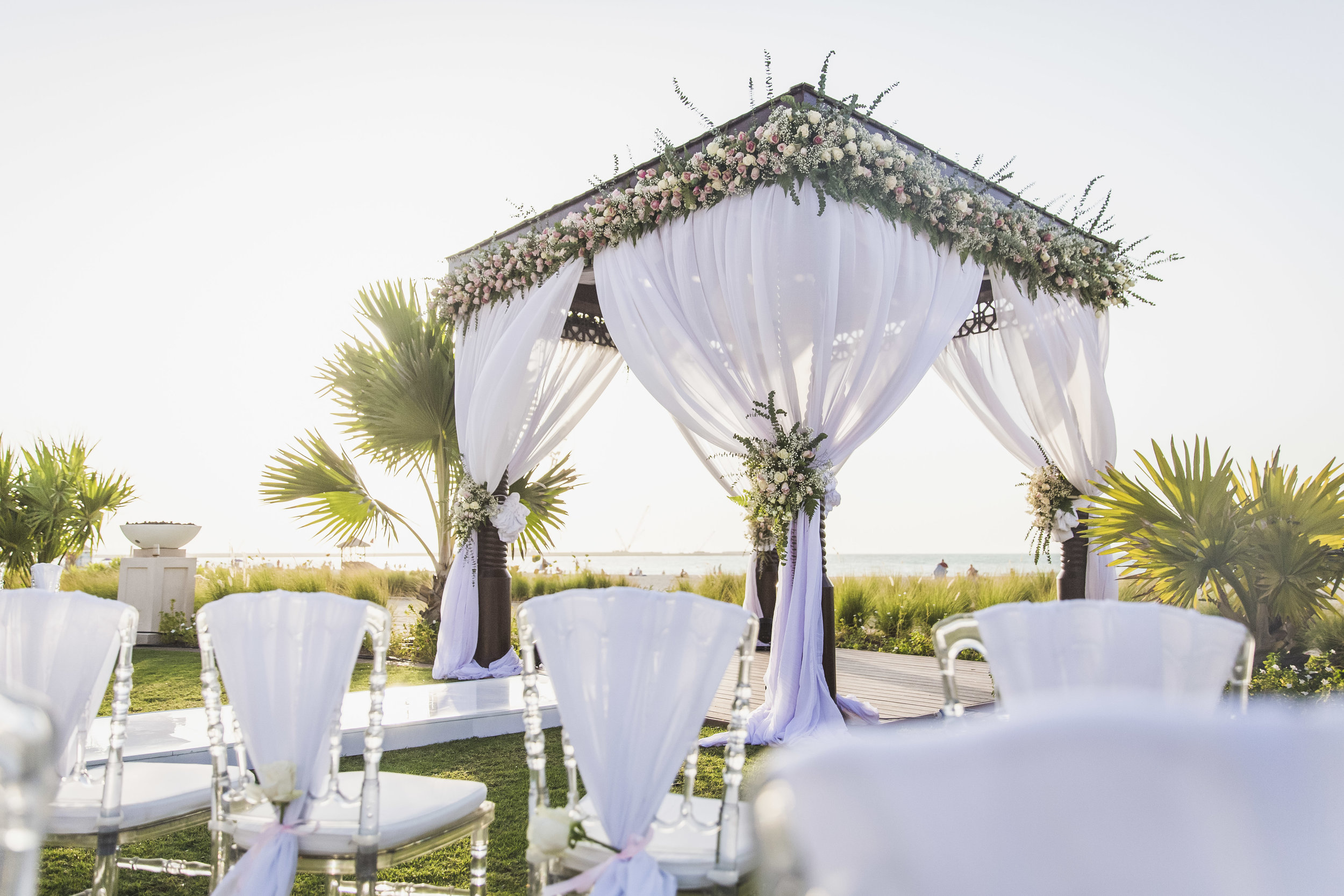 Outdoor wedding ceremony setting with chairs and podium