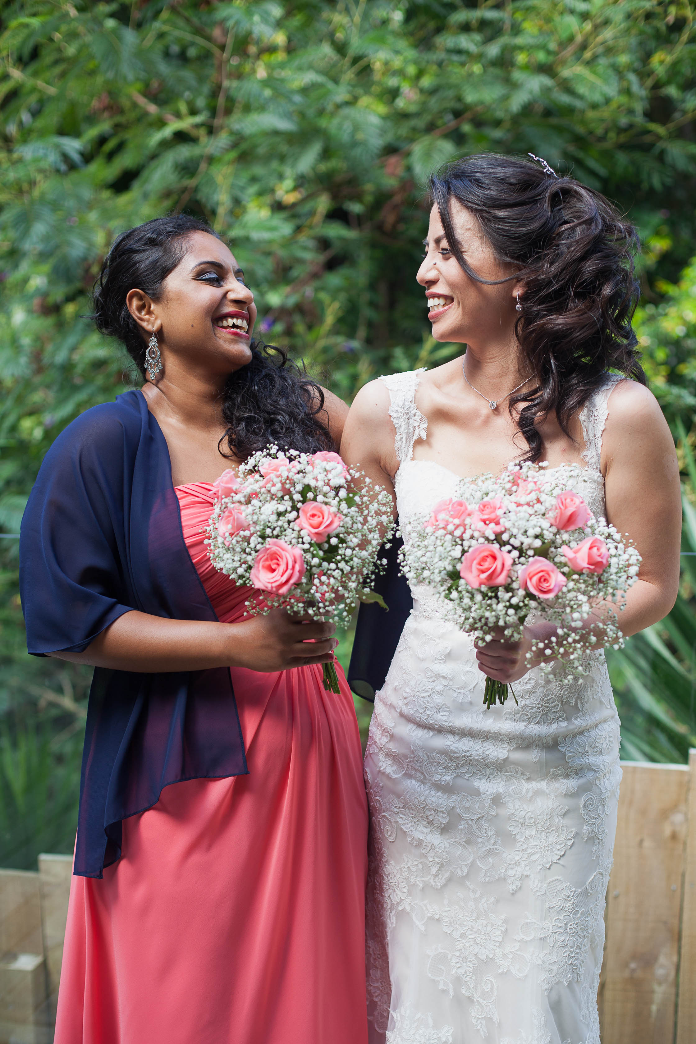 Bride and Bridesmaid Laughing