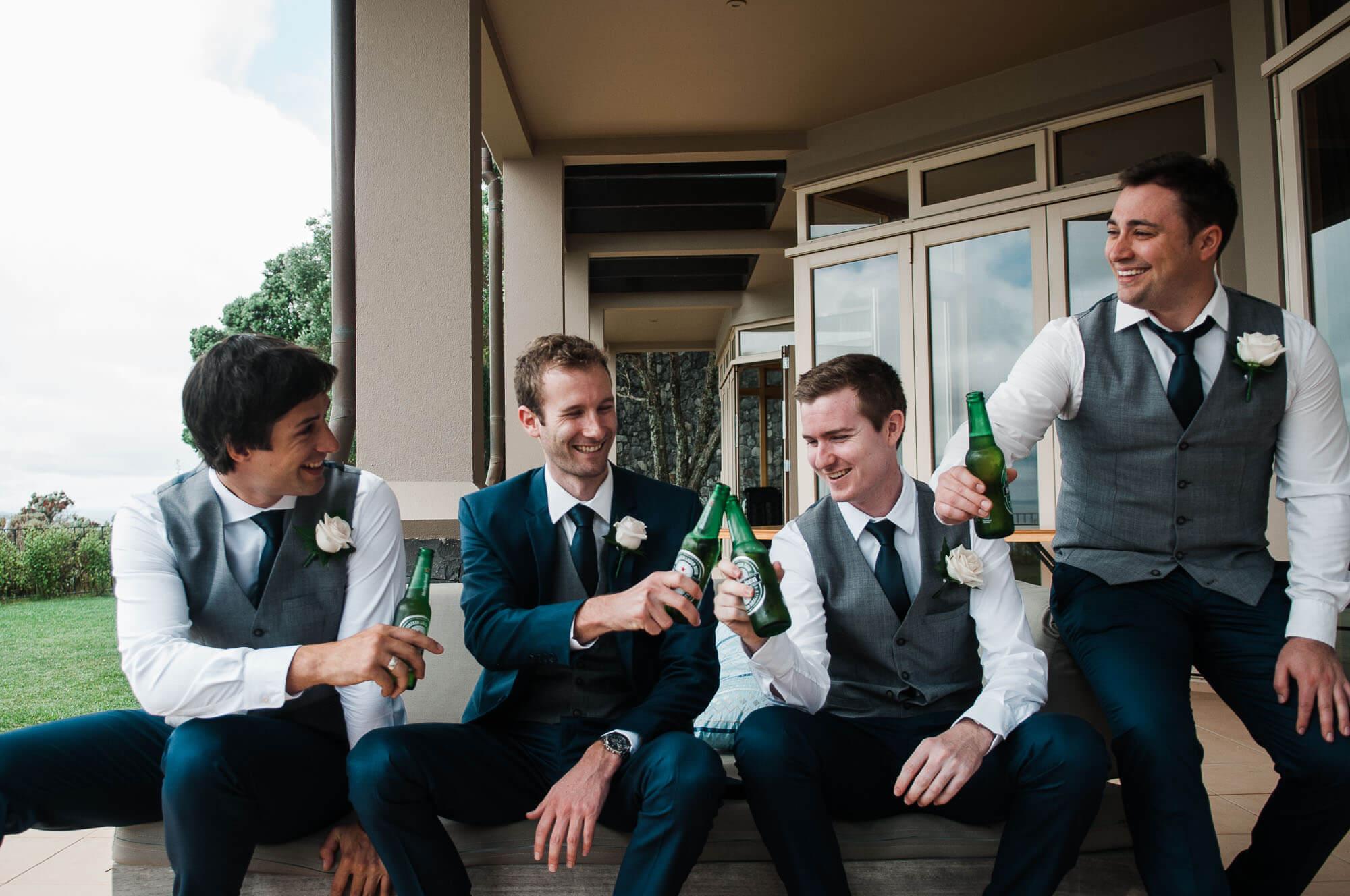 groom-and-groomsmen-cheers-with-beer.jpg