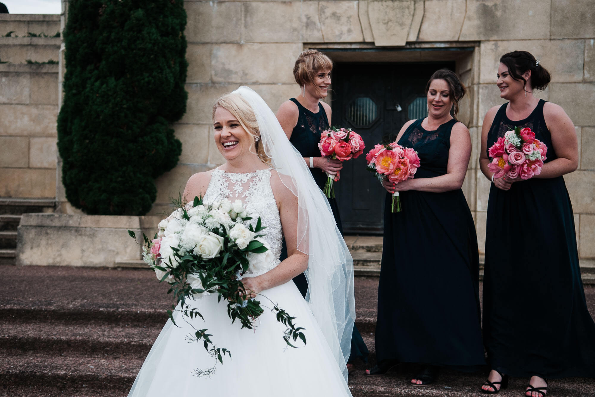 bride-laughing-with-bridesmaids-in-background.jpg