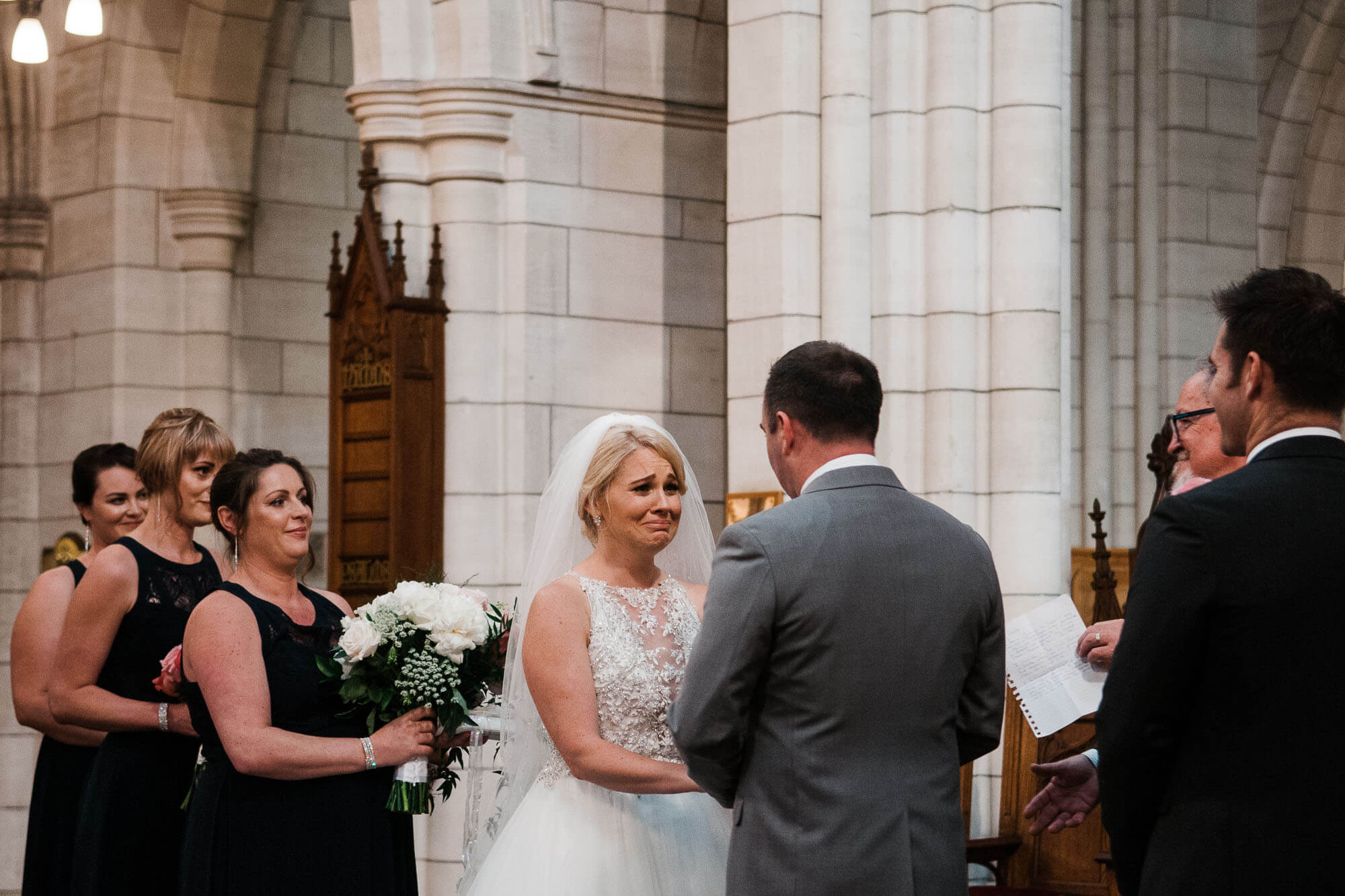 wide-shot-of-bride-laughing-at-altar.jpg