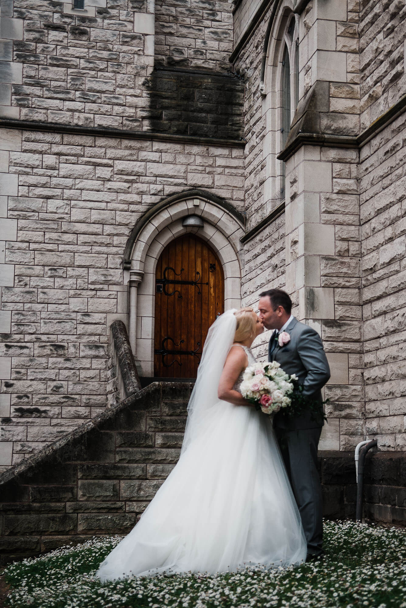 bride-and-groom-kissing-outside-church.jpg