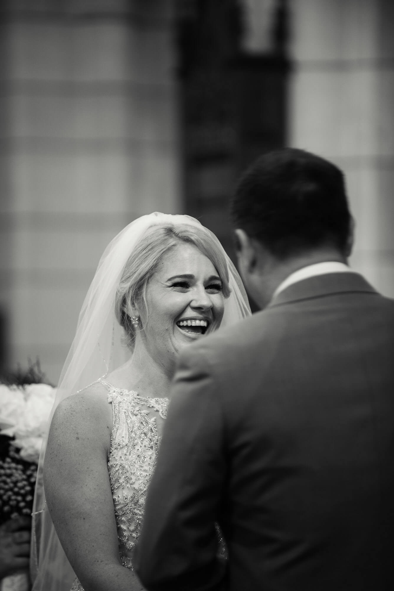 bride-laughing-at-altar.jpg