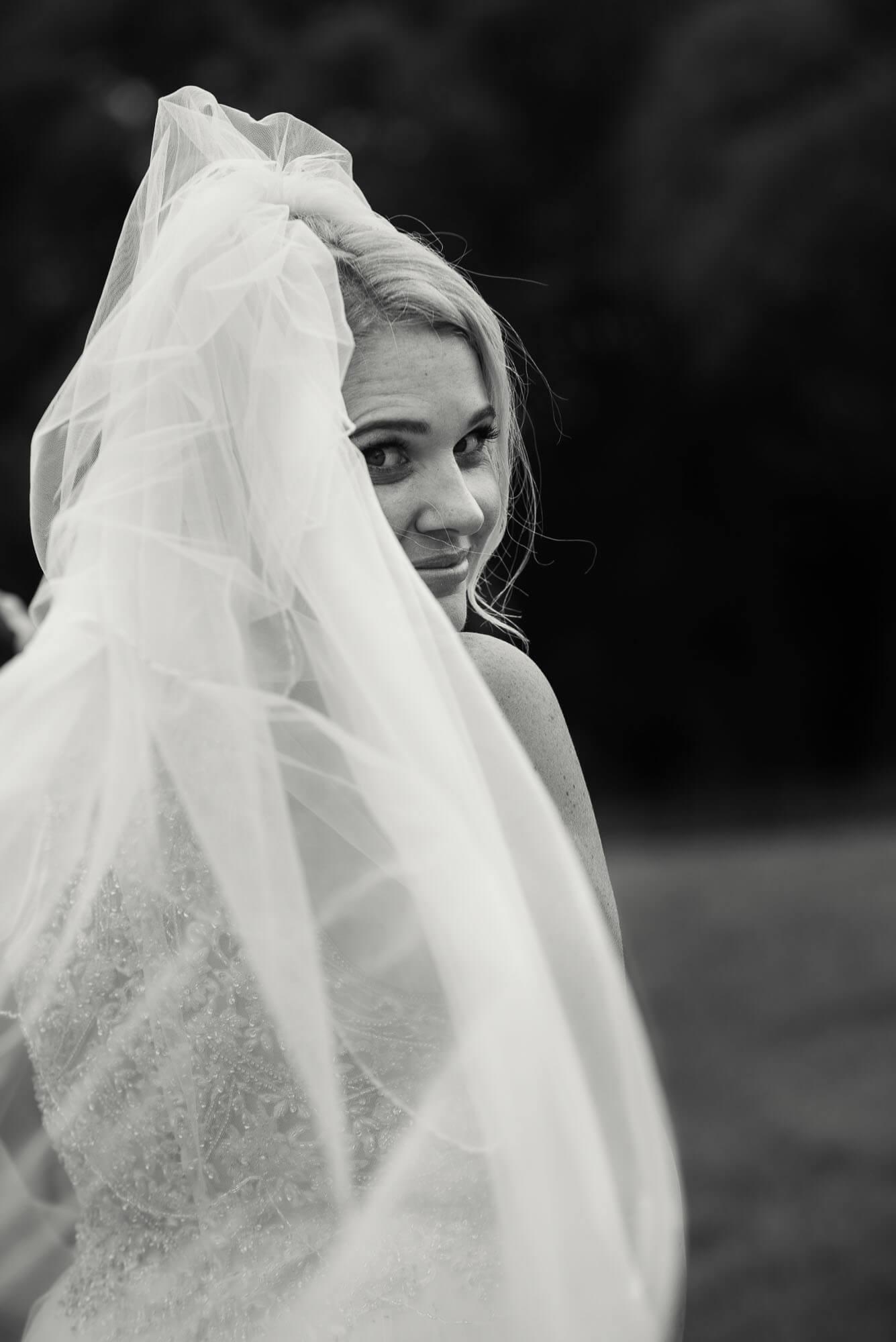 bride-looking-over-her-shoulder-black-and-white.jpg