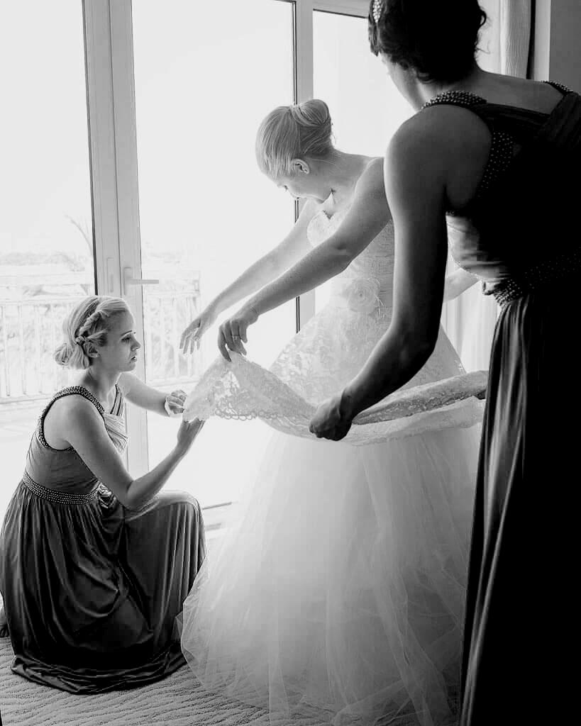 bridesmaids-help-bride-layered-boho-wedding-dress.jpg