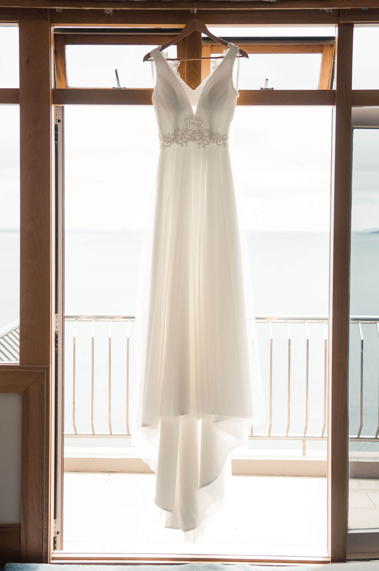 wedding-dress-hanging-in-window.jpg