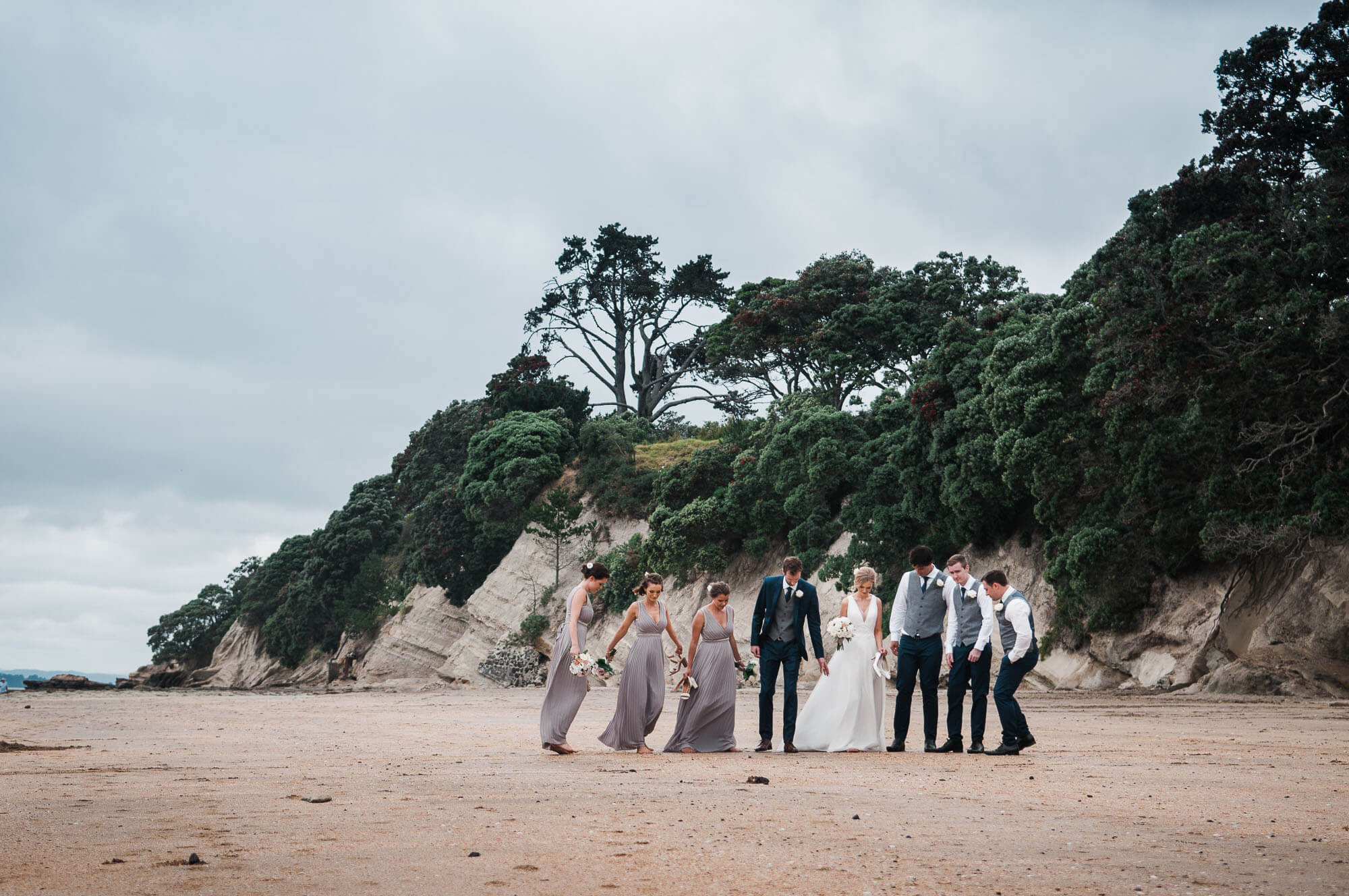 bridal-party-walking-along-beach-relaxed-and-natural-wedding-photography.jpg