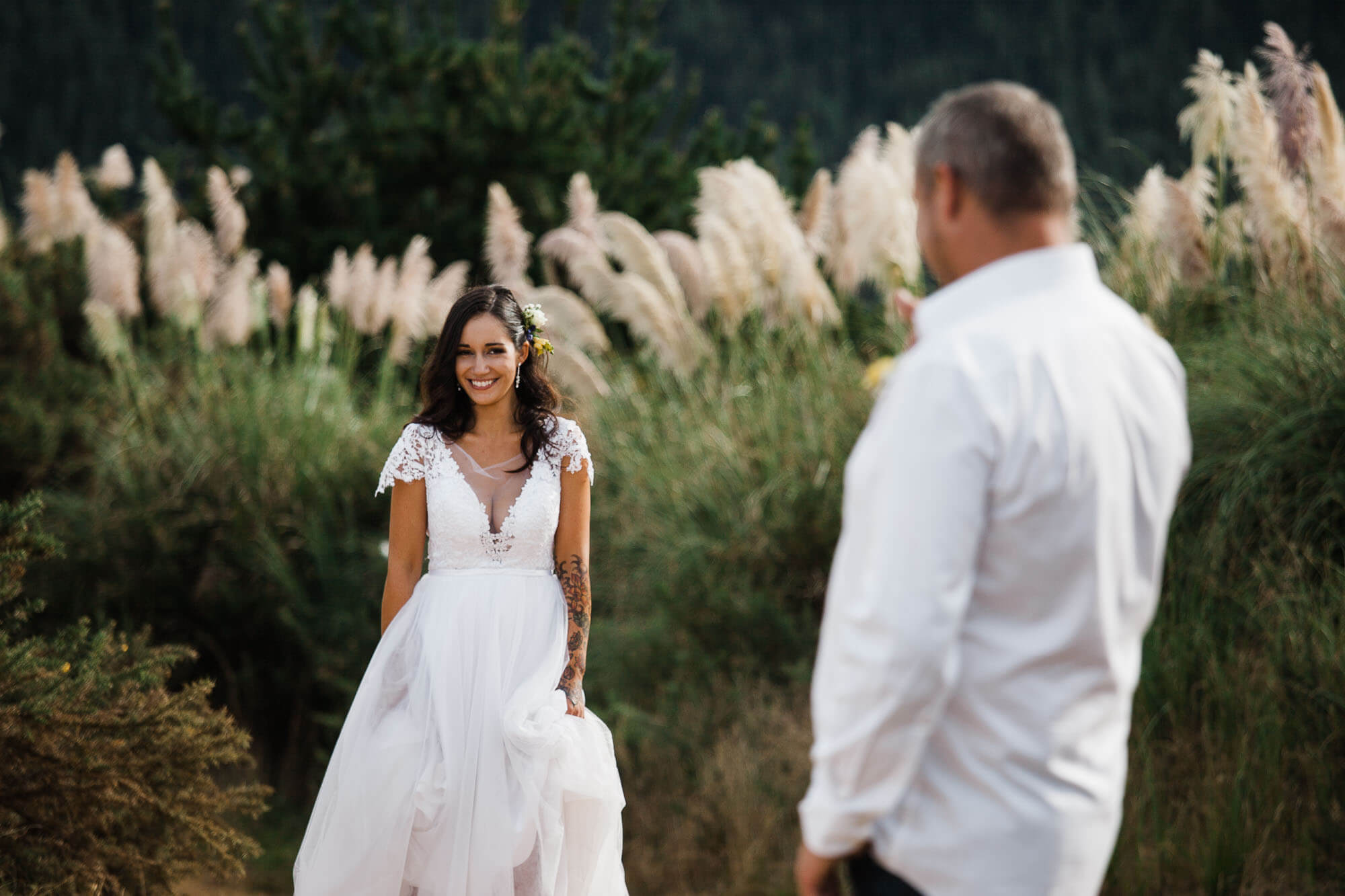 bride-walking-towards-groom-boho-outdoor-wedding.jpg